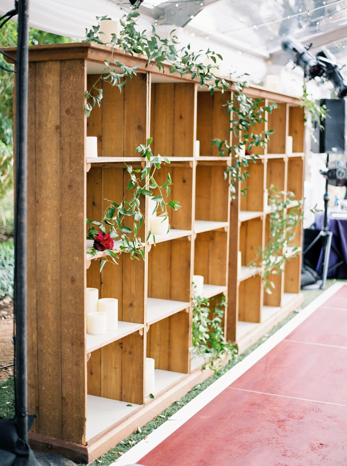 greenery garland and single rose adhered to shelves