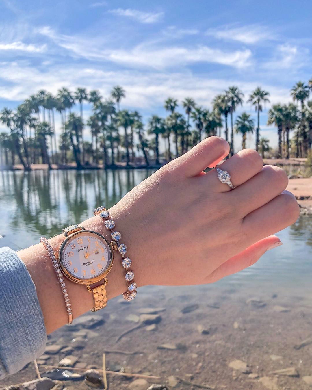 engagement ring selfie palm trees and a body of water