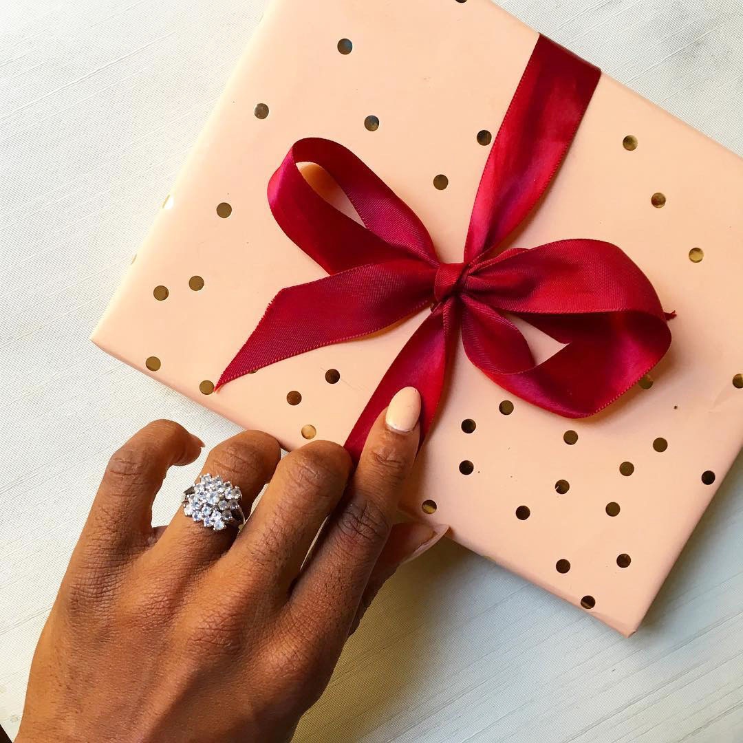 engagement ring selfie unwrapping polka dot patterned gift box