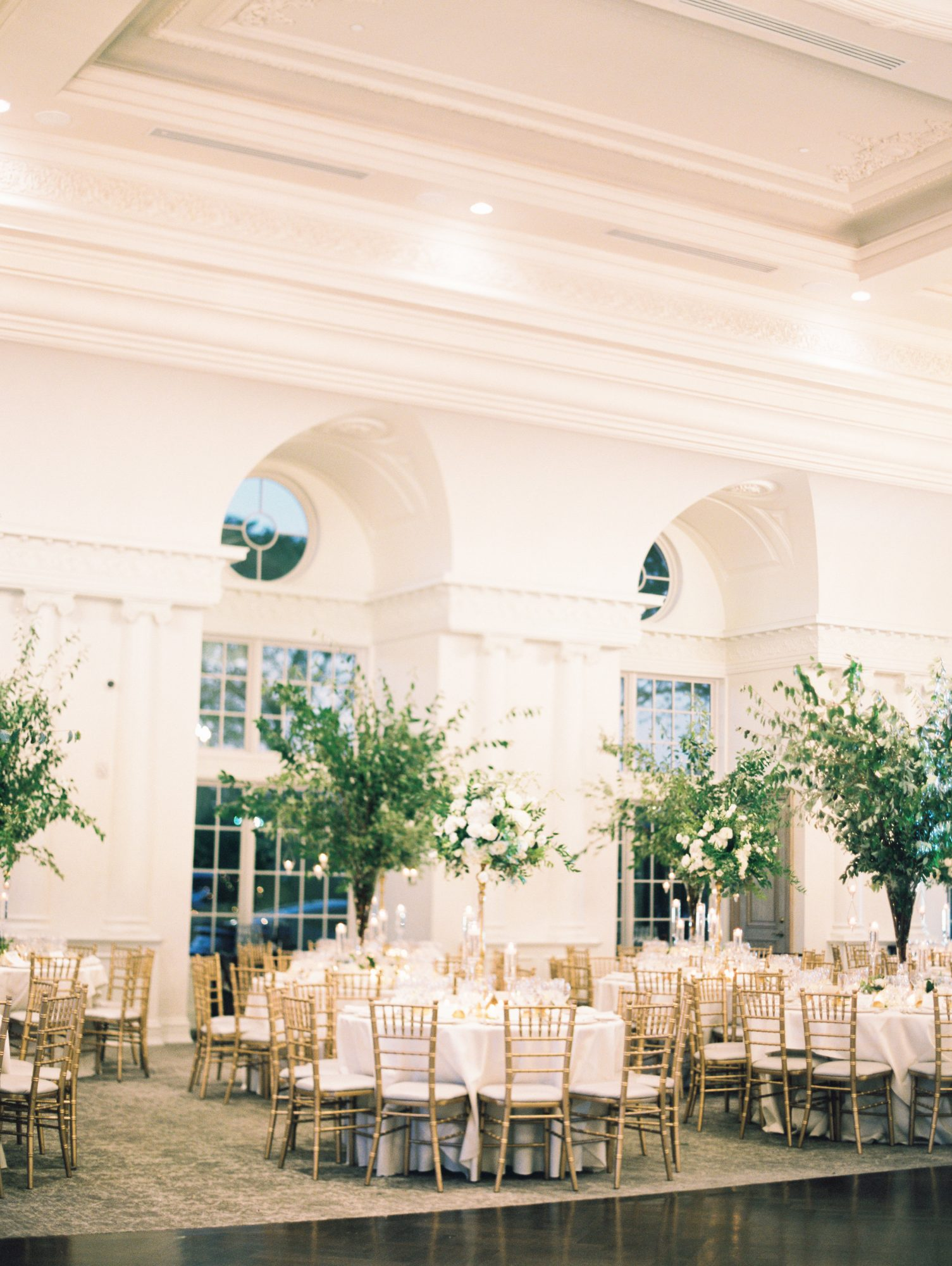 formal wedding reception with tall centerpieces