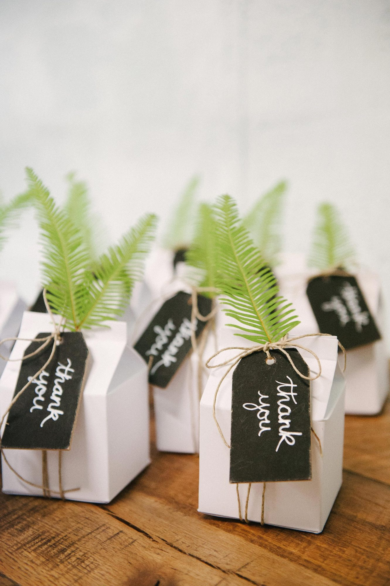 favor boxes with greenery