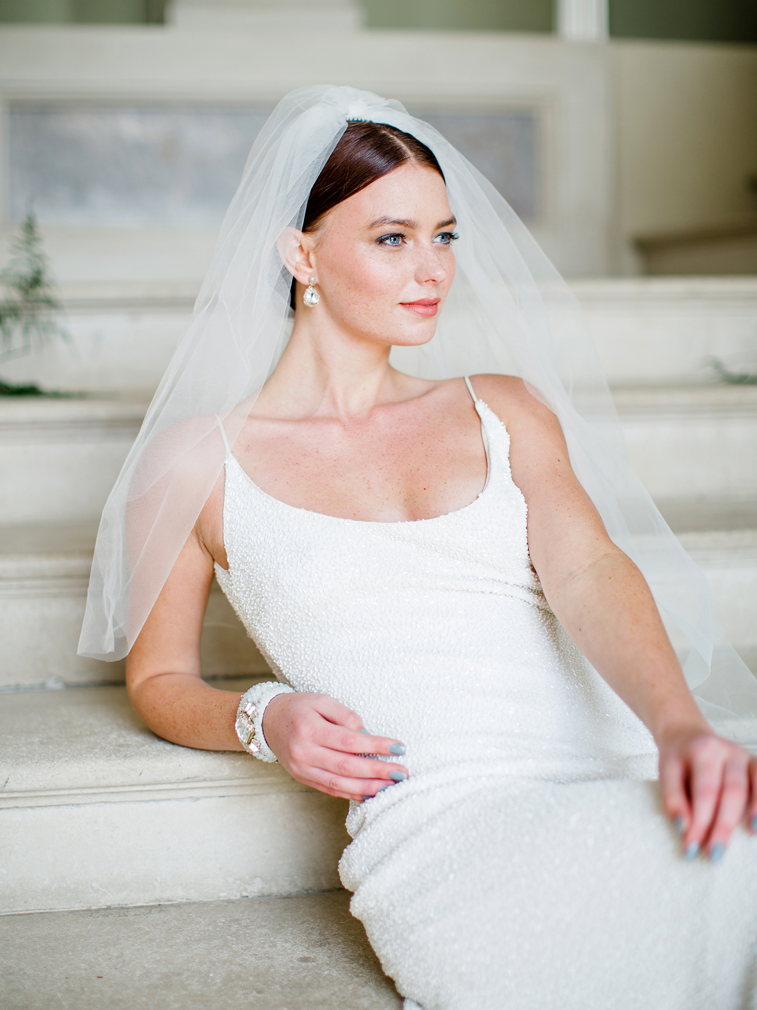 bride with sleek chignon and veil