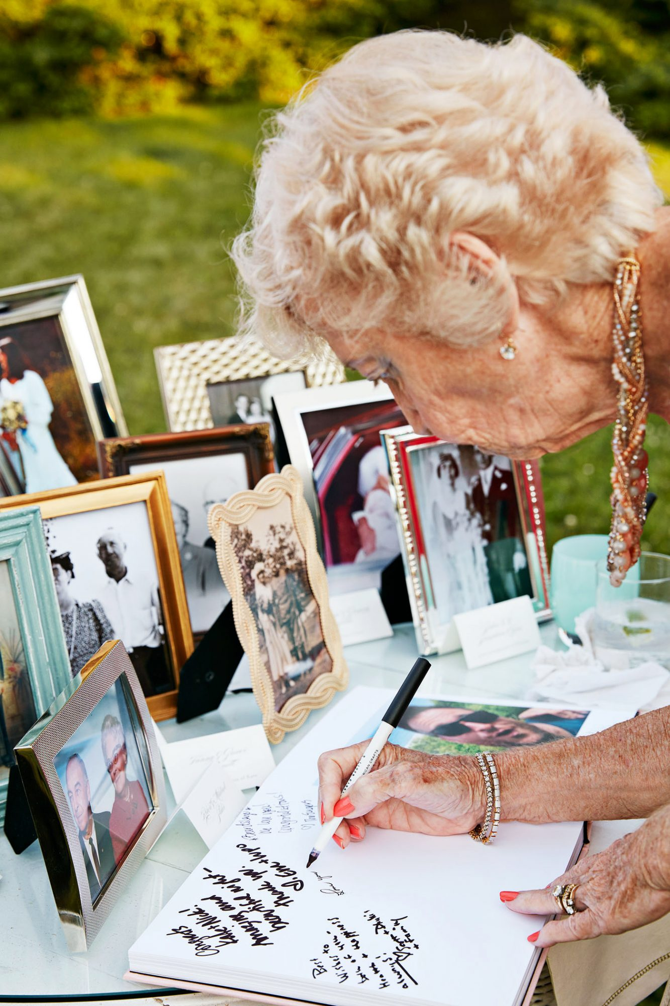 wedding grandmother signing  guest book