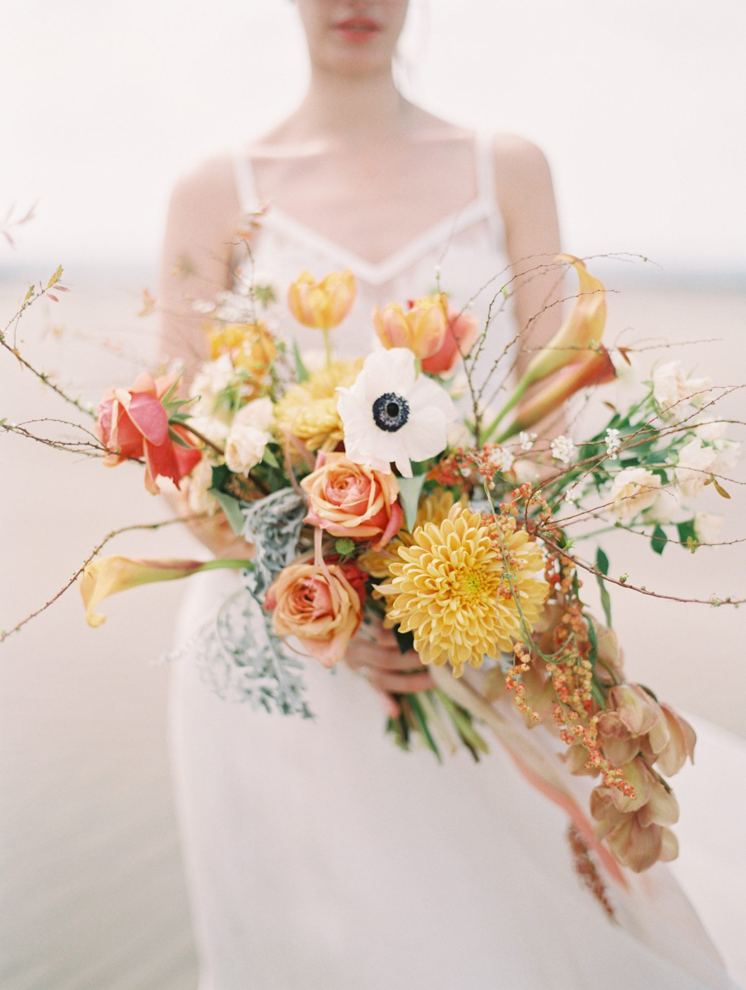 orange bouquet with calla lilies dahlias and roses