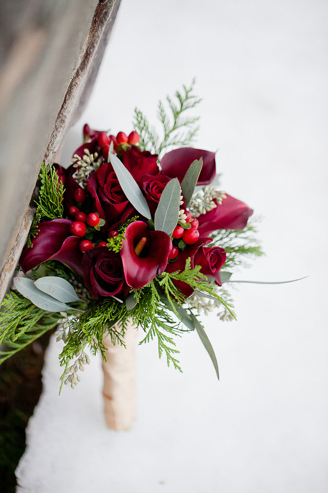 bouquet with red calla lilies berries and roses