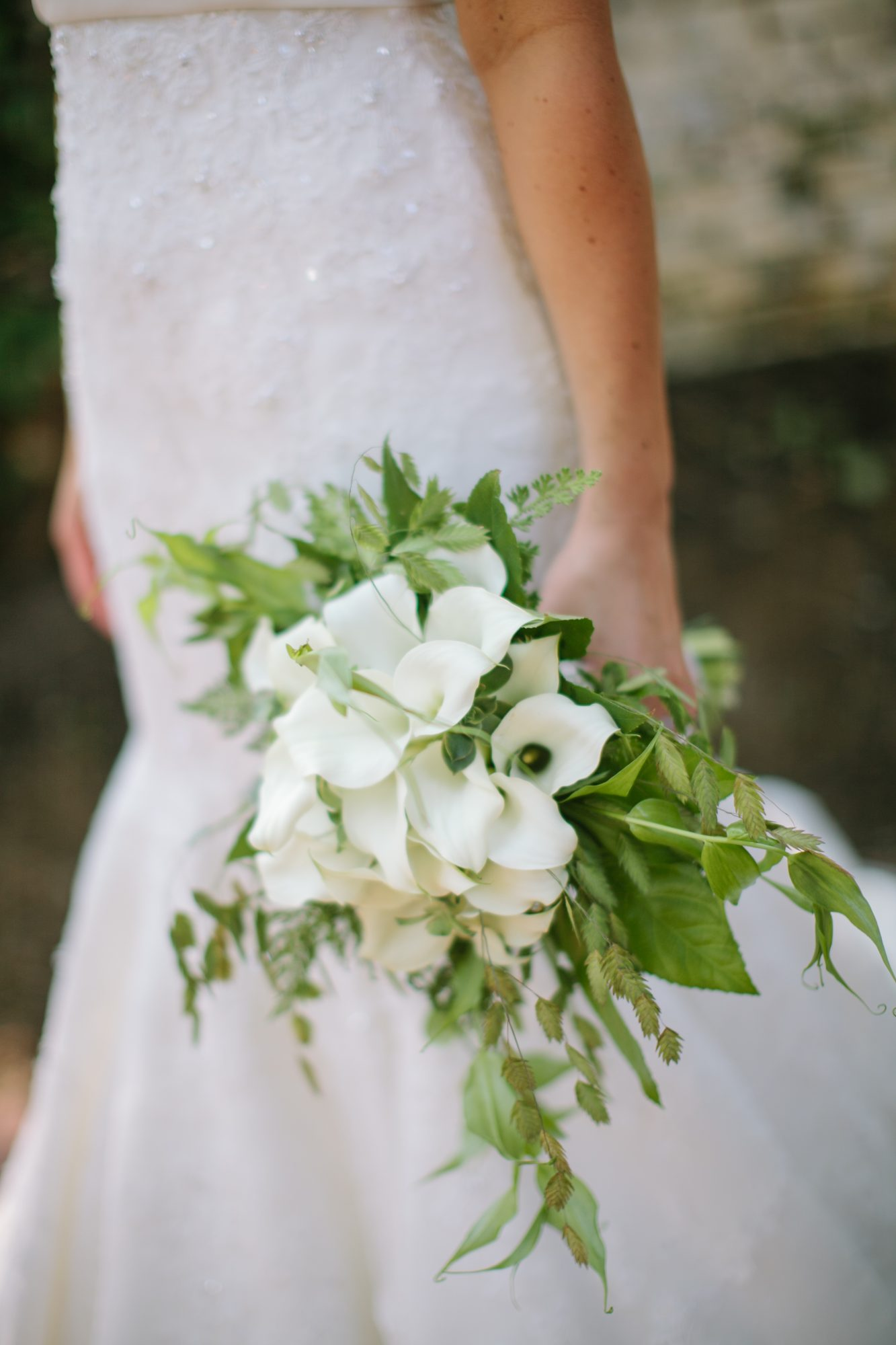 bouquet with white calla lilies and greenery