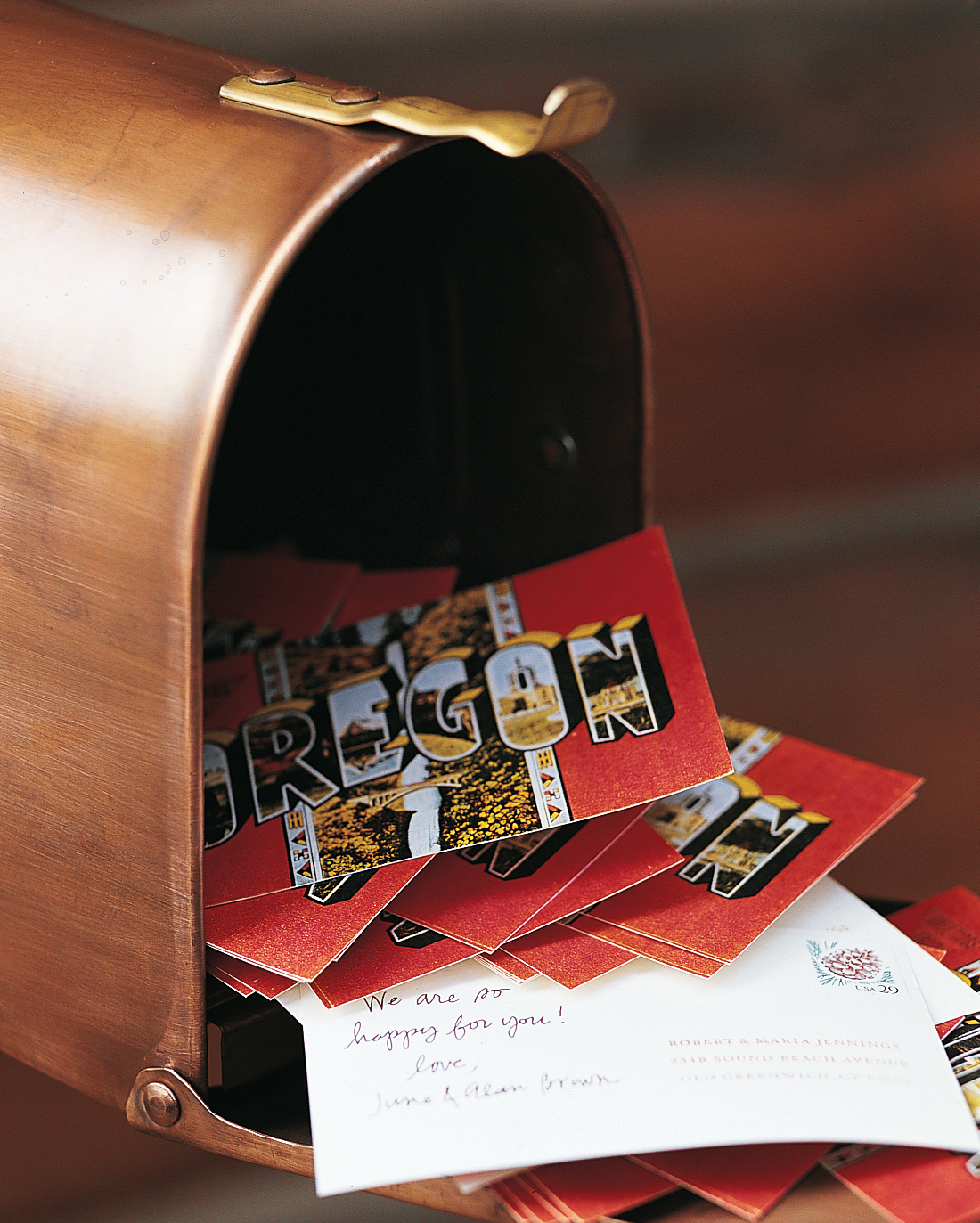 Rather than signing a traditional guest book, guests at this wedding were given postcards with the bride and groom's address printed on the back to fill with good wishes during the reception and drop in a copper mailbox displayed in the lobby. The cards were to be mailed the next day by a friend of the couple so that the newlyweds would return from their honeymoon to a brimming mailbox.