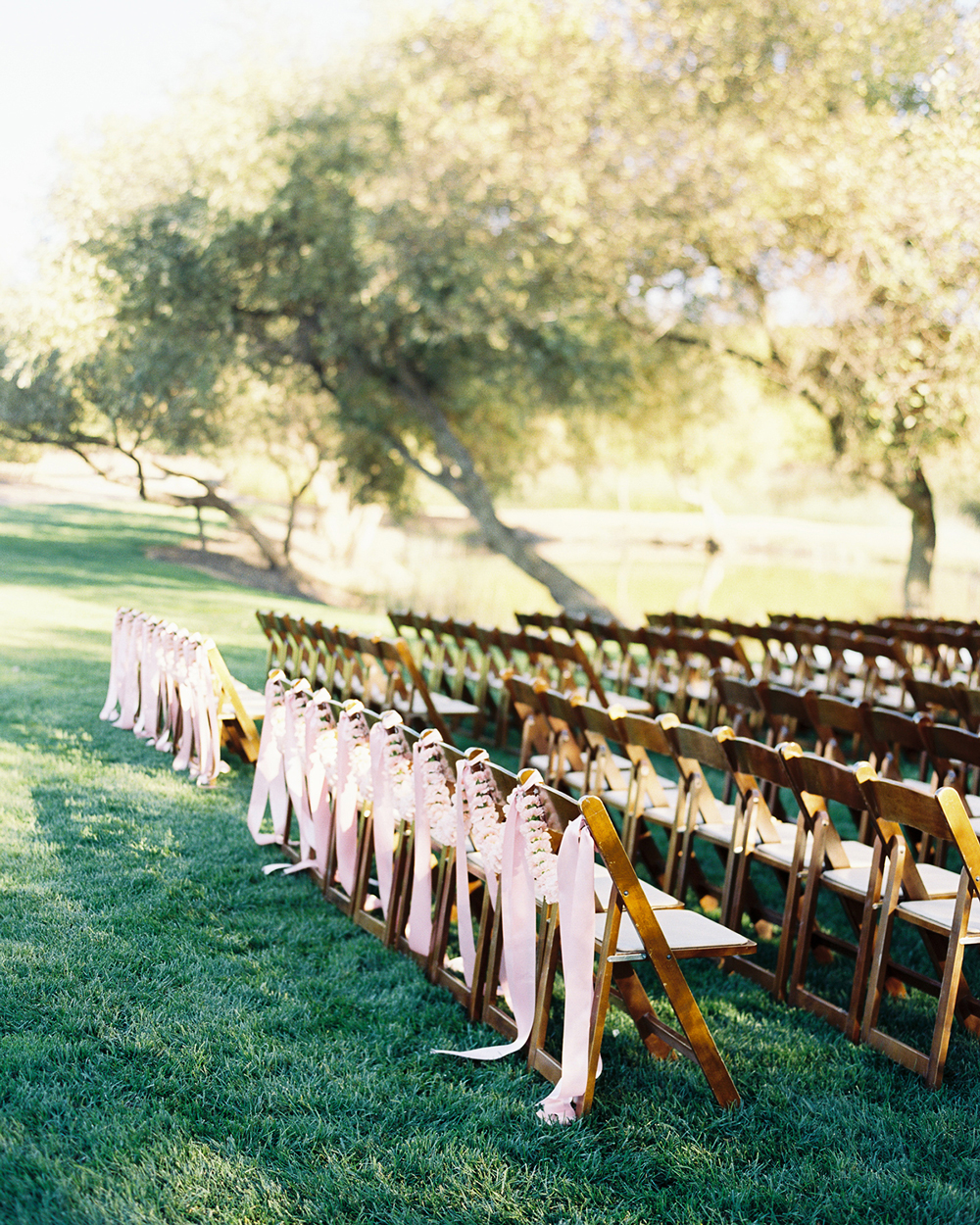ribbon wedding ideas pink ribbon adhered to back row of ceremony chairs