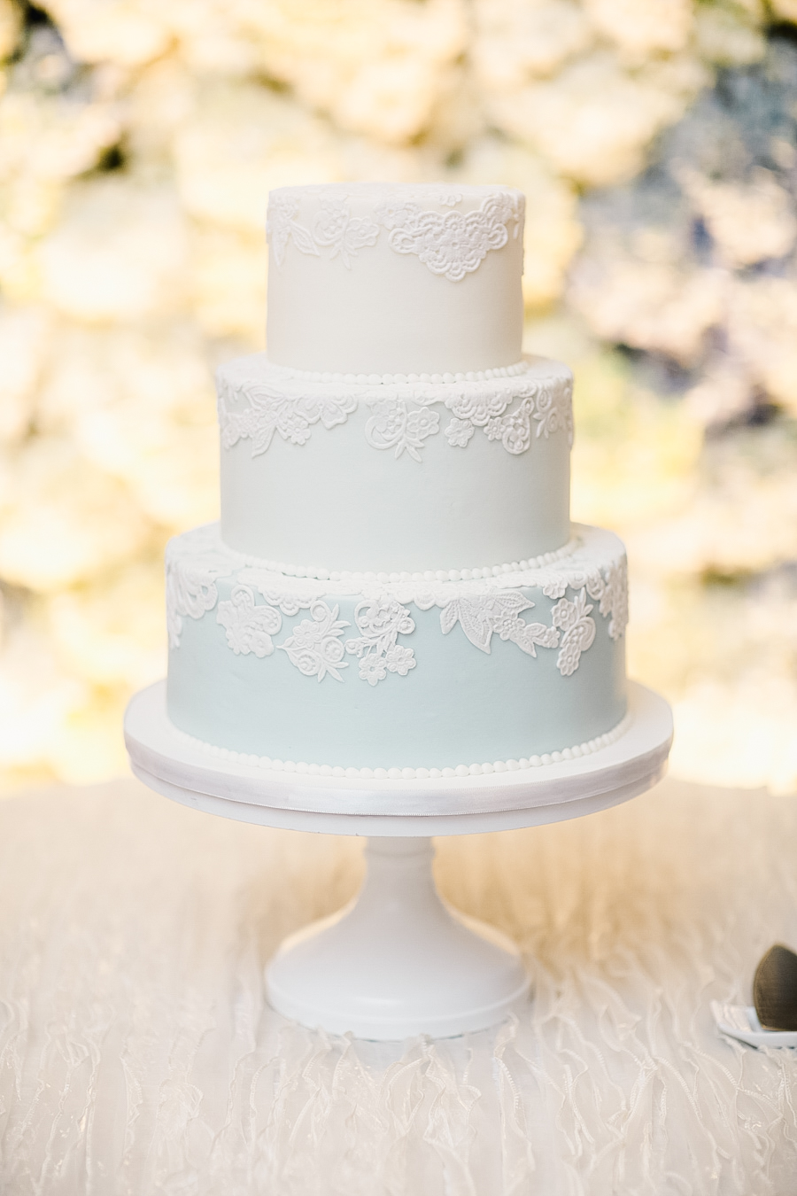 lacy cake on pedestal
