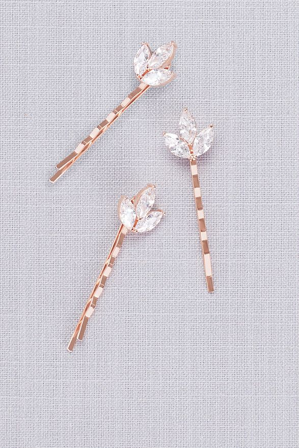 close-up Triple Petal Crystal Hair Pin Set on gray fabric