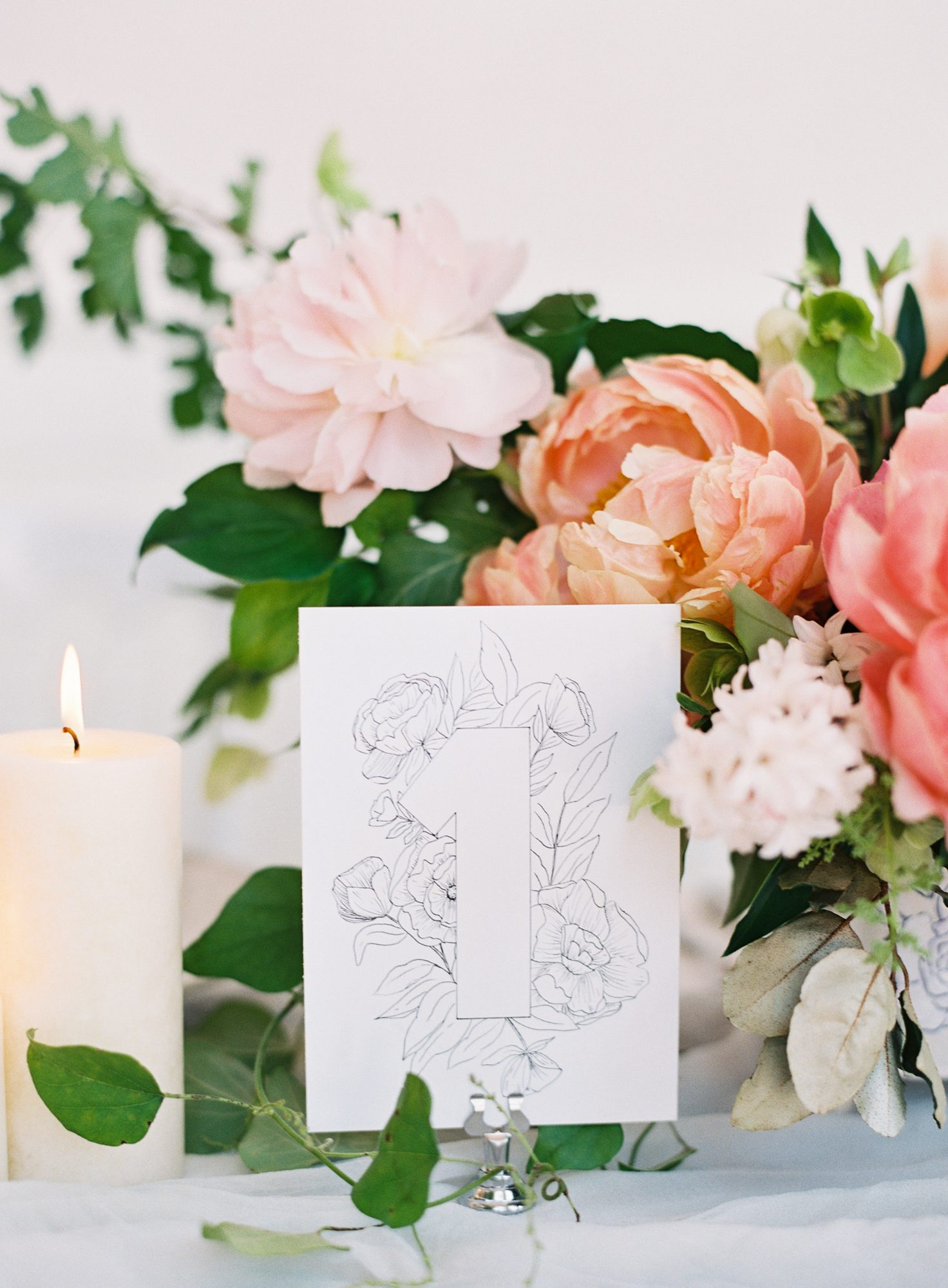 Elegant and romantic floral illustration wedding table number with peach and pink wedding centerpiece