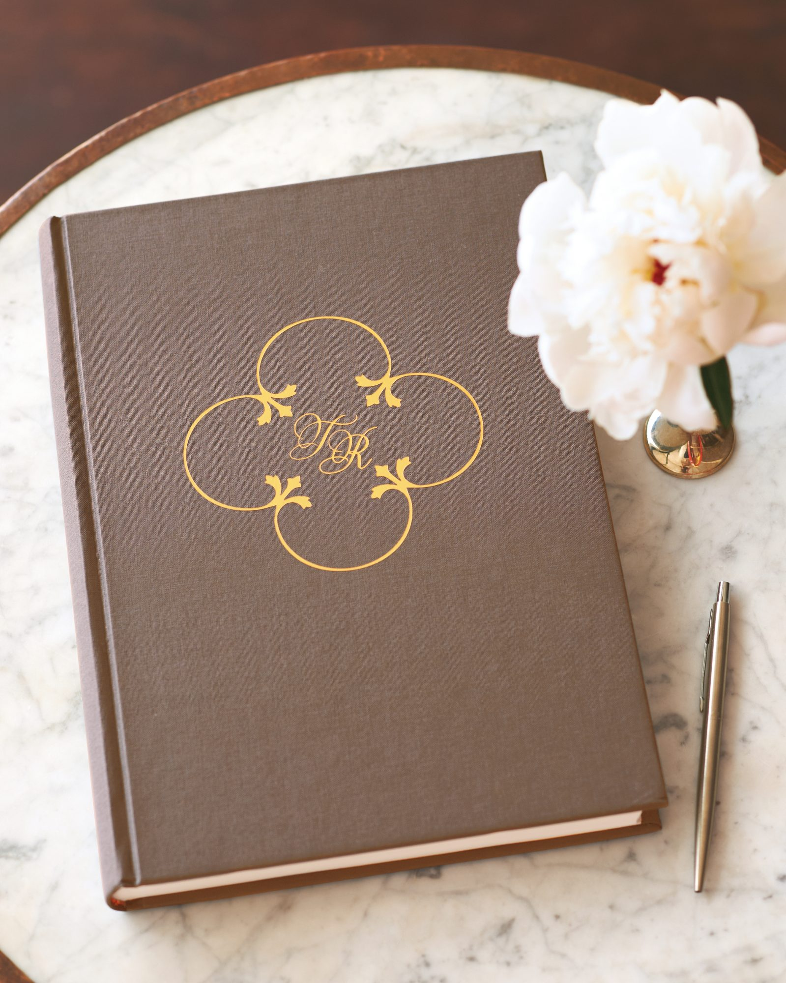 The couple's initials (and wedding motif) adorned the guest book at their nuptial bash.