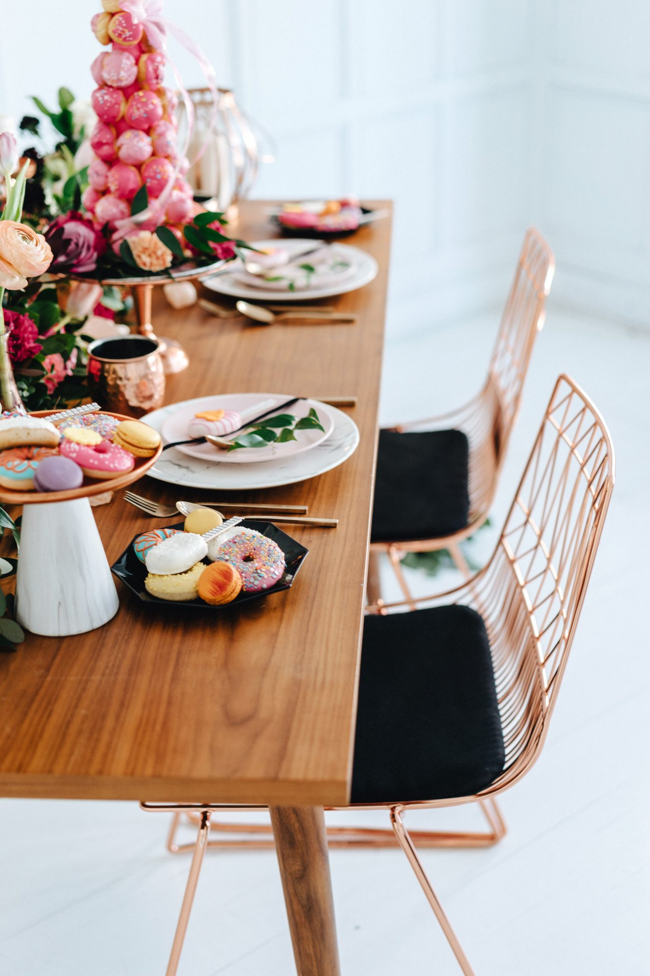 copper wire chairs with black cushions