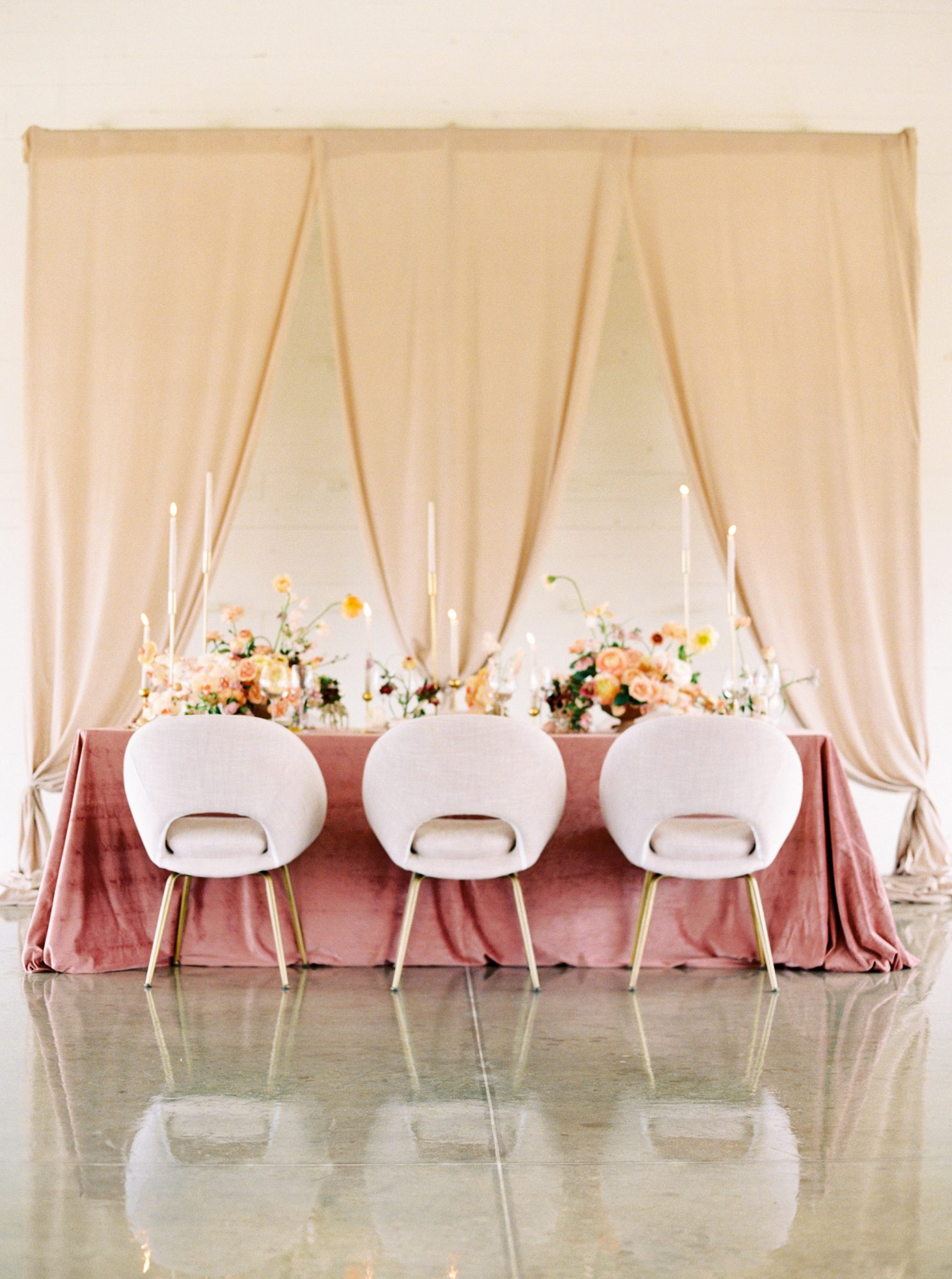 pink chairs with curved backs