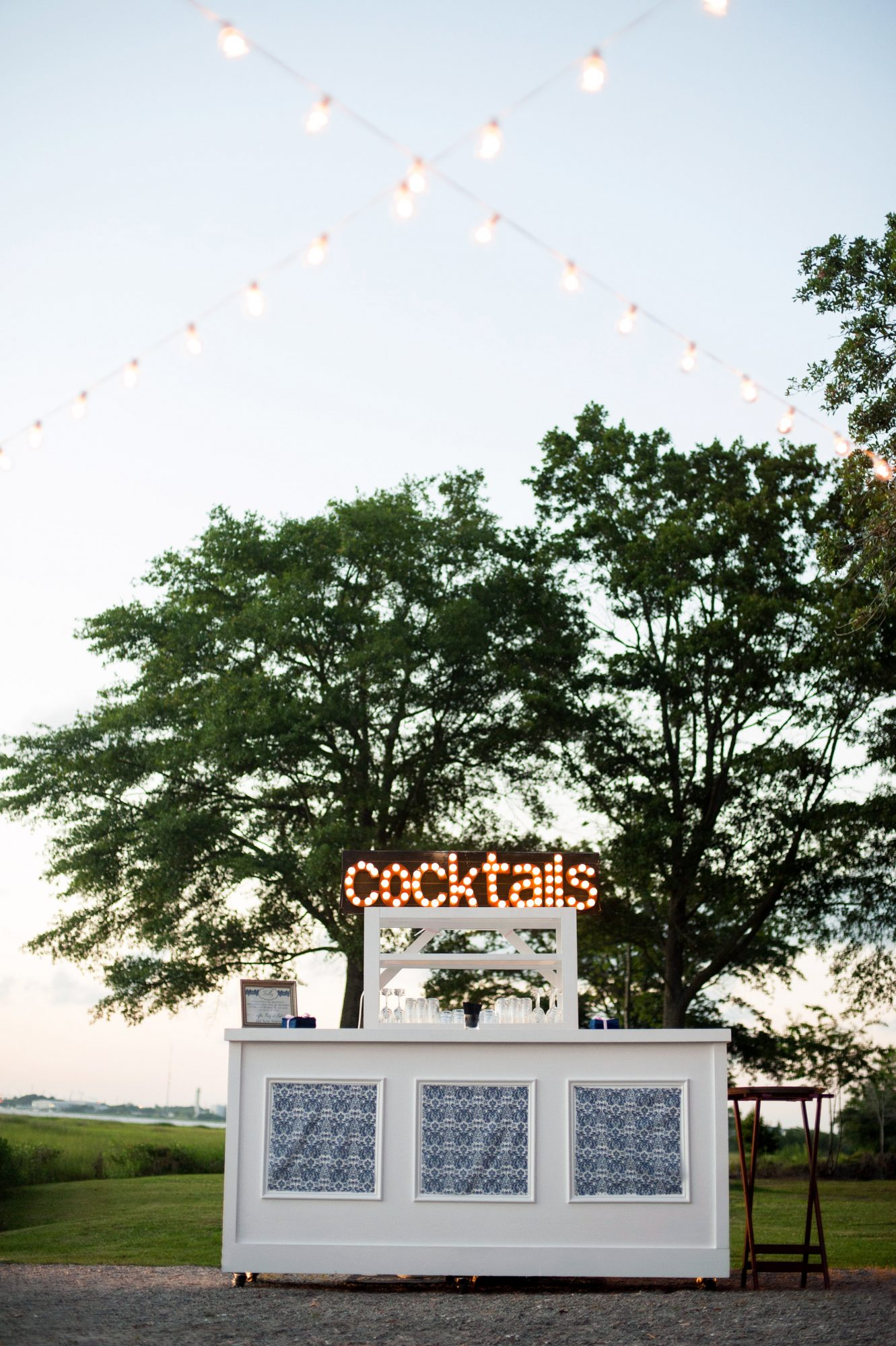 wedding bar sign cocktails white outdoor trees