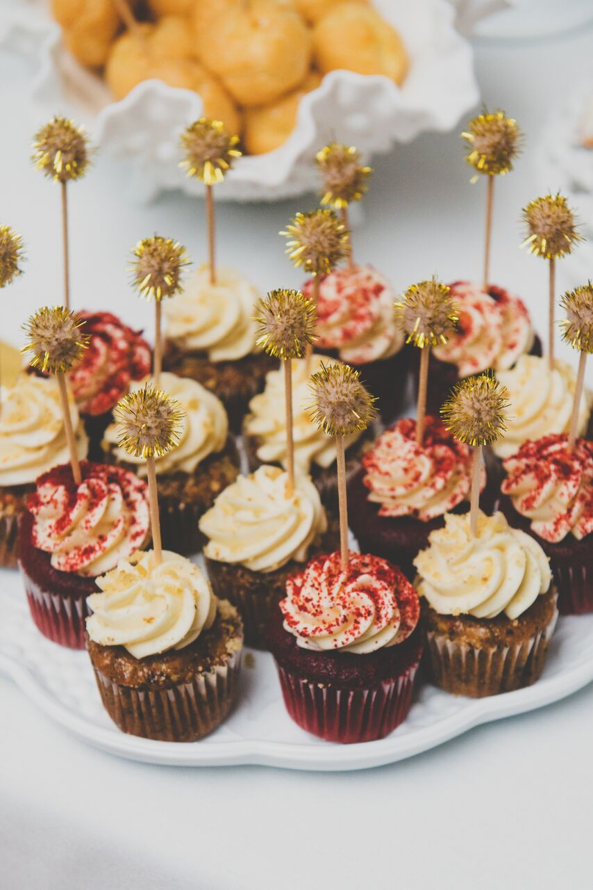 cupcakes with red and yellow sprinkles