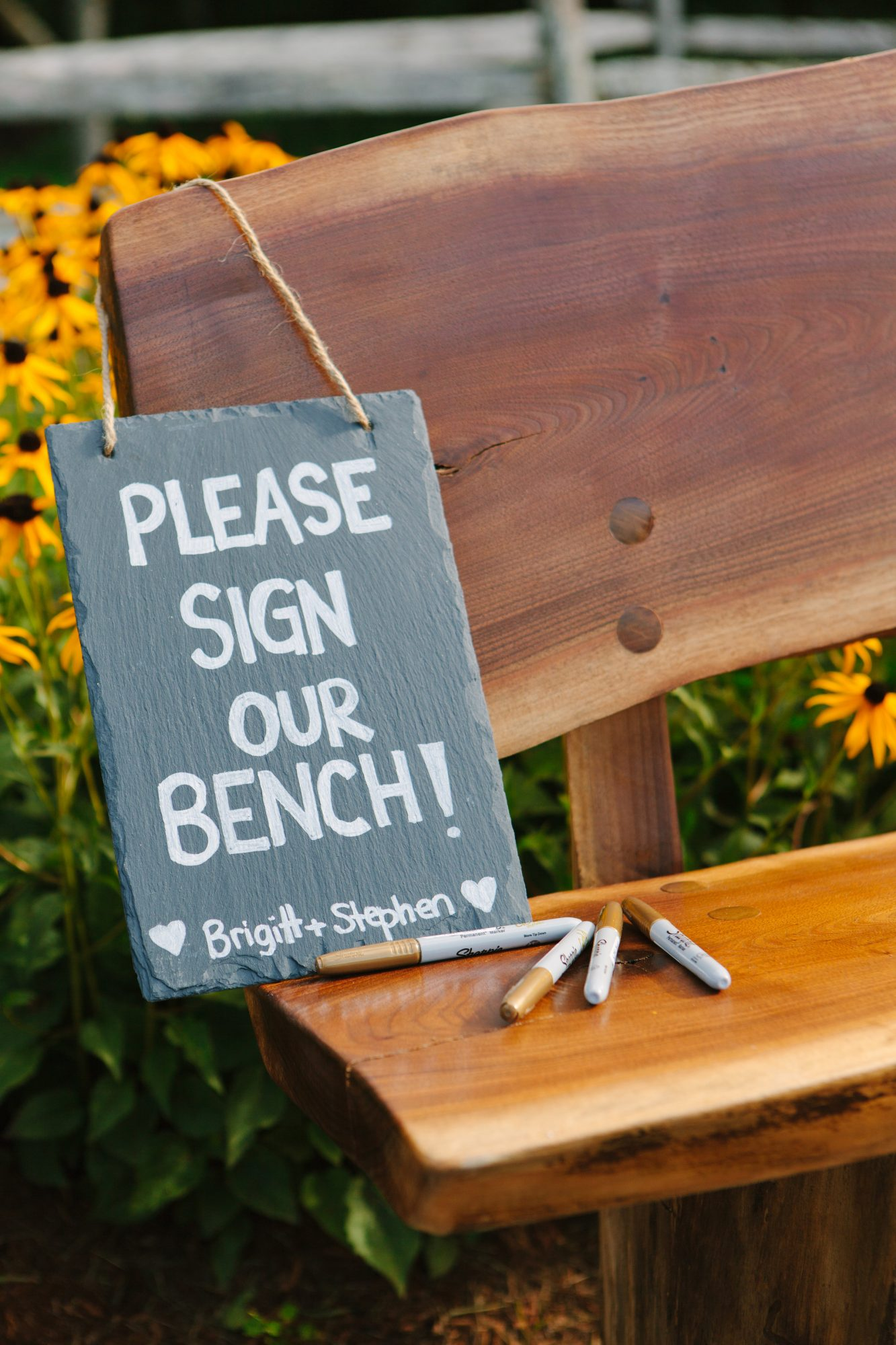 This couple had celebrants sign a bench instead of a book, which they could later put in their home.
