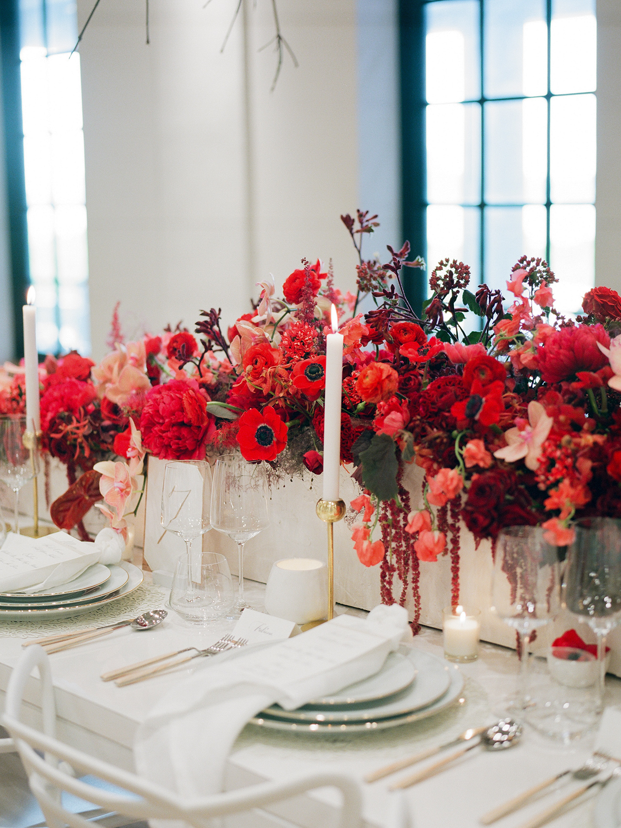 red floral arrangement white table setting