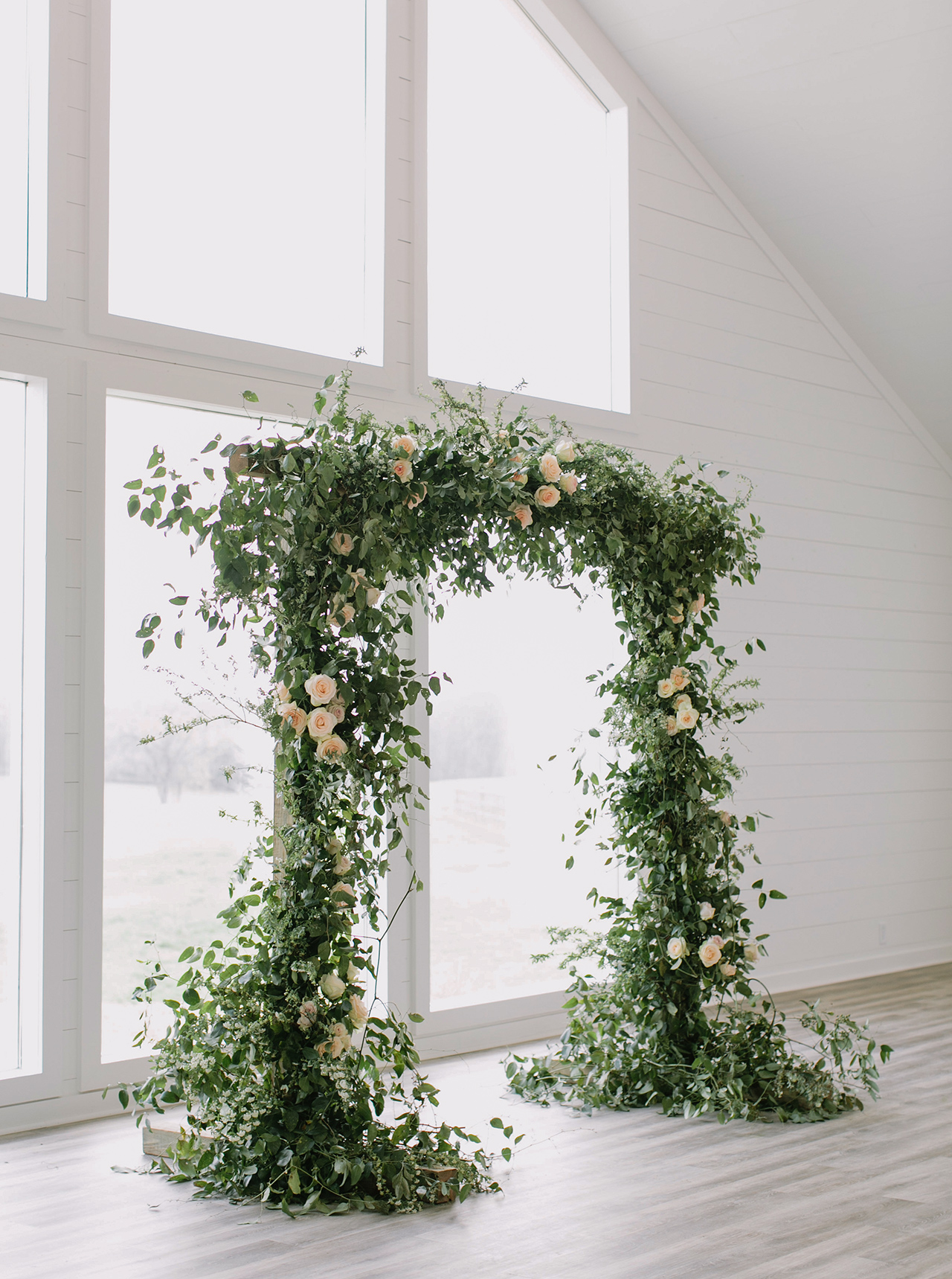 green white wedding ceremony arch window space