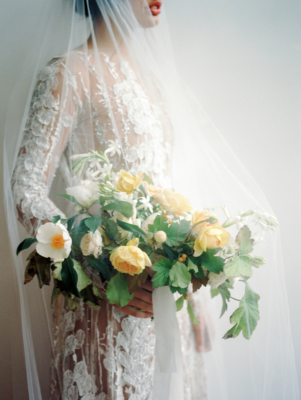 yellow roses and white florals with greenery bouquet