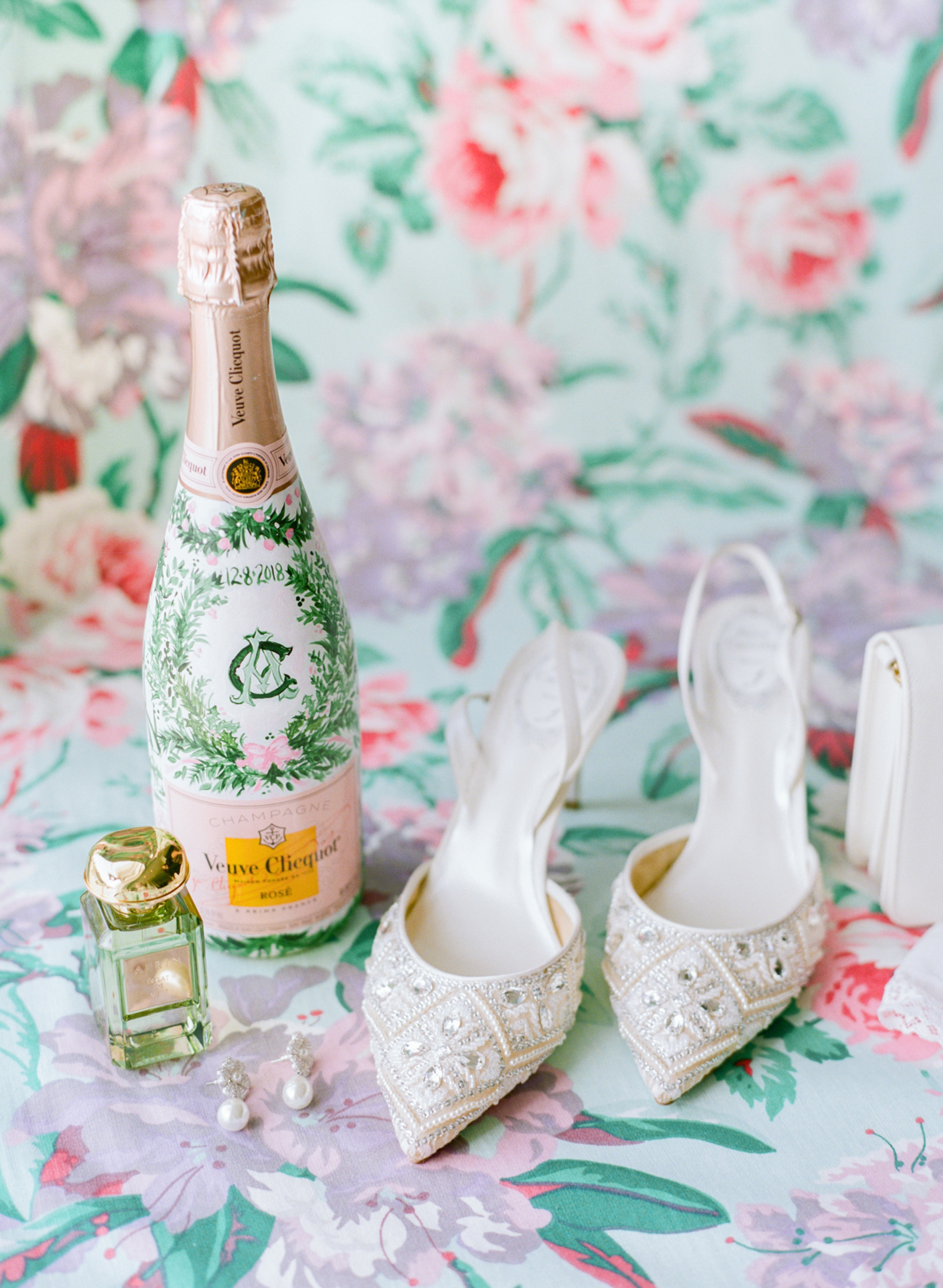 custom designed champagne bottle with white pointed toe heels