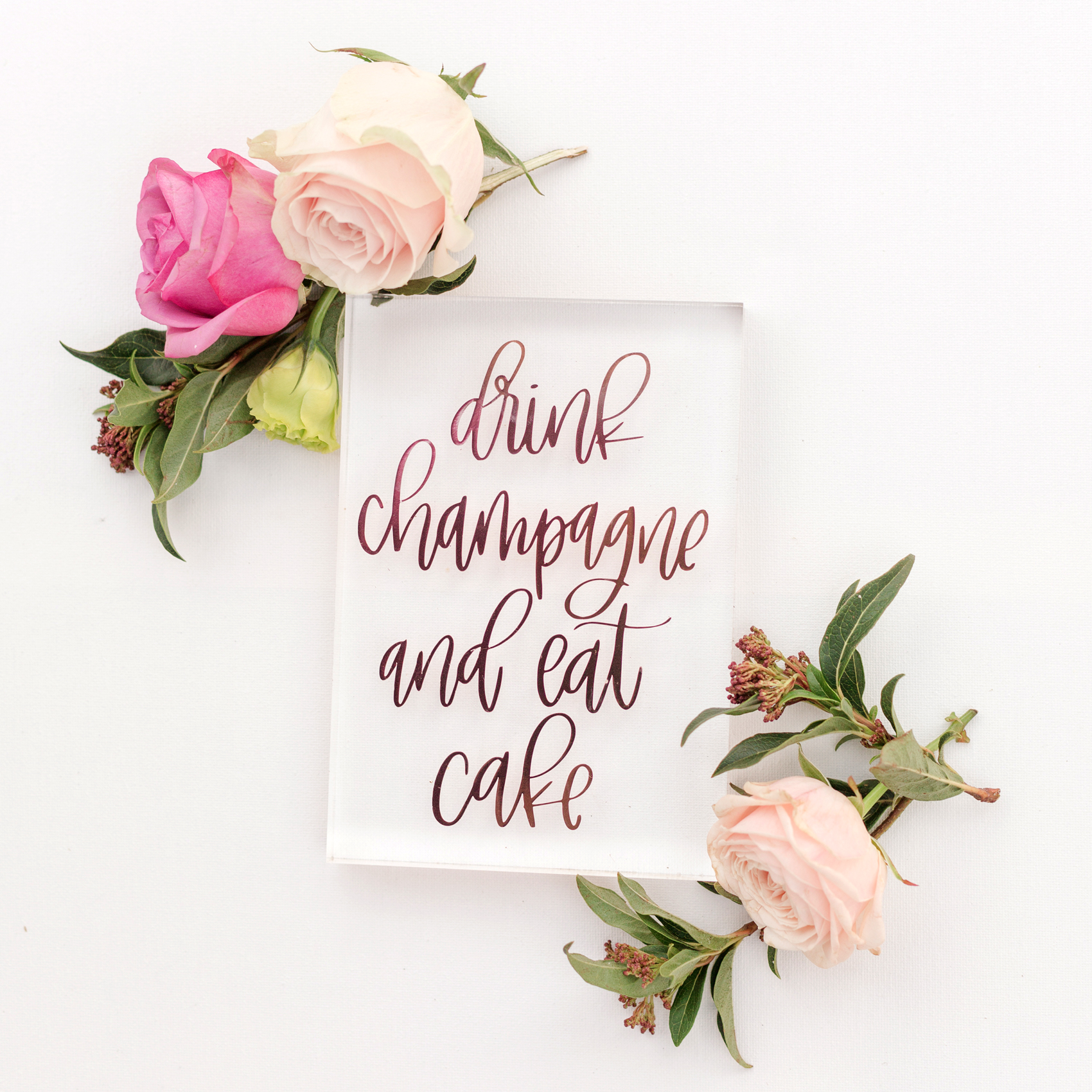 drink champagne and eat cake rose gold sign