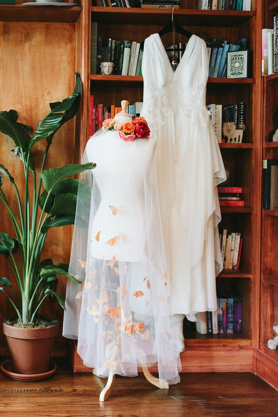 wedding dress and colorful butterfly embroidered veil