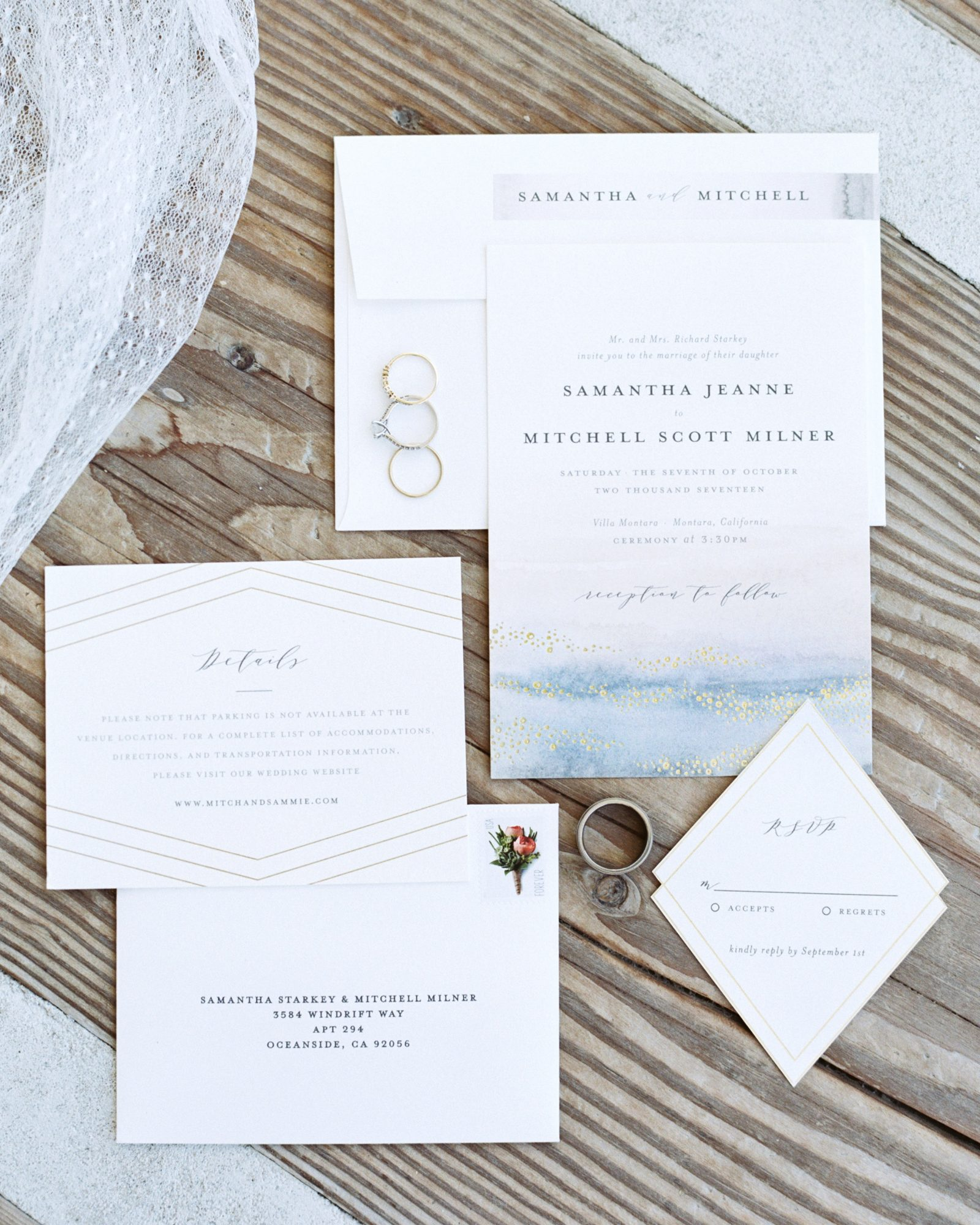 Faint pops of blue and gold—which looked like the sun sparkling off the sea—gave this California wedding's Minted invitations a beachy vibe.