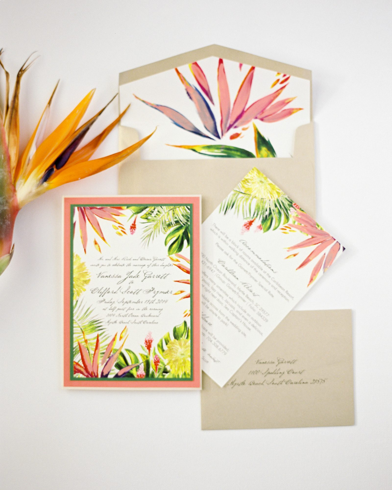 Beach wedding invitations don't have to include blue, especially if your destination boasts more scenery than just the ocean itself. Momental Designs used yellow, pink, and green for this tropical suite.