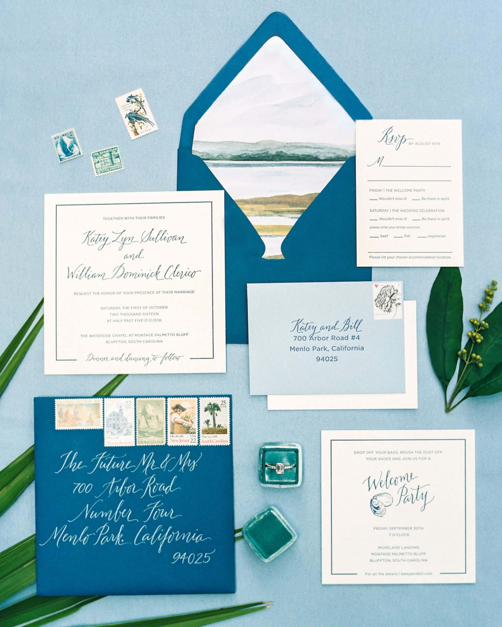 If you're getting married somewhere with a view of the ater, showcase that landscape with a painted envelope liner. Lowcountry Paper Co. also chose a pair of mismatched blue envelopes as another way of channeling the water that surrounded this couple's destination.