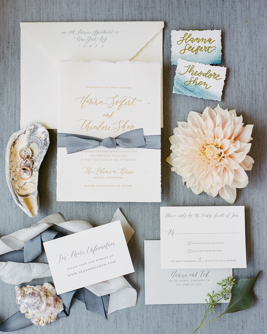 The deckle-edged paper used for theseCopper Willow Paper Studio invites resembled ocean waves. Gray-blue ribbon tied the theme in even more.