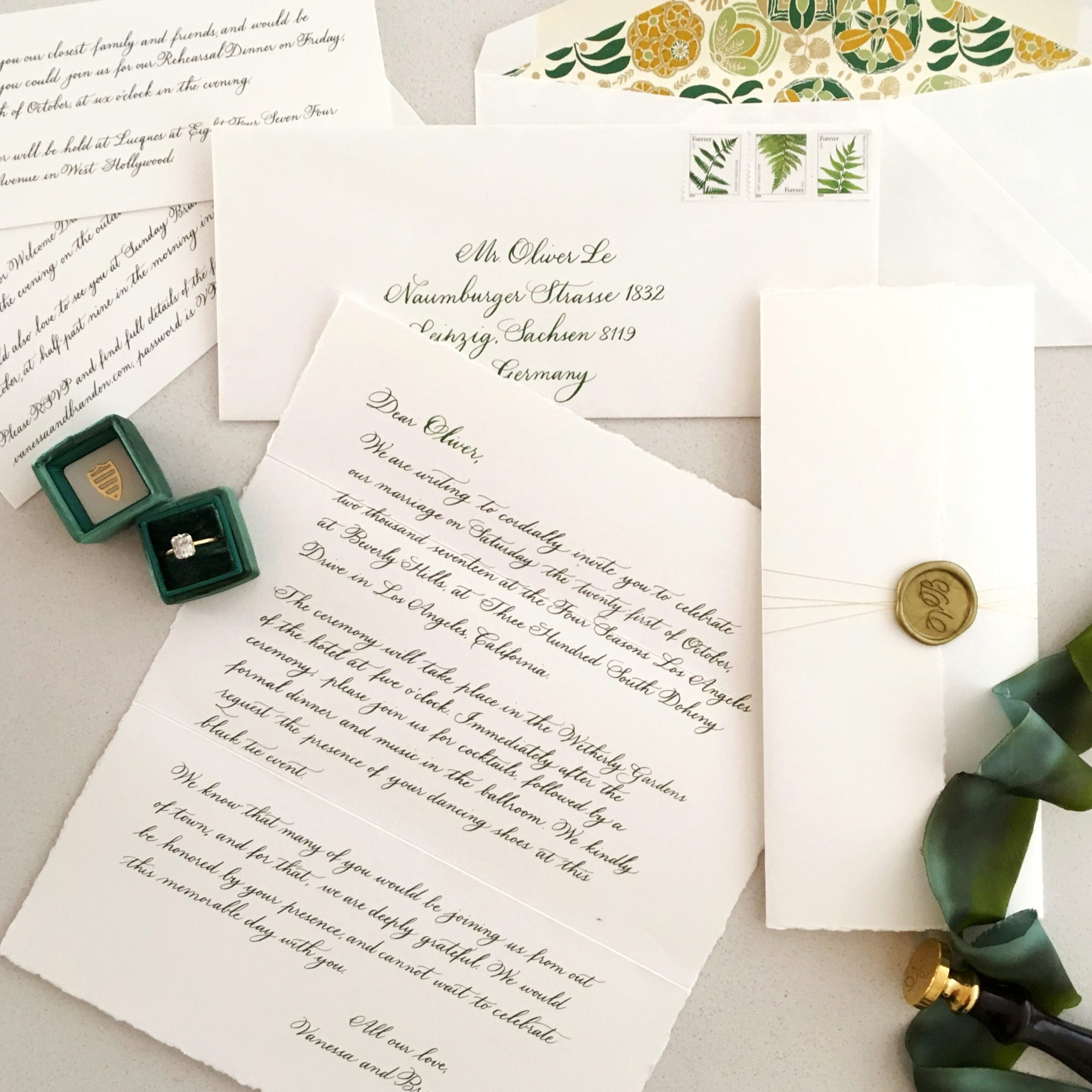 classic invitation calligraphy writing with gold thread and wax seal