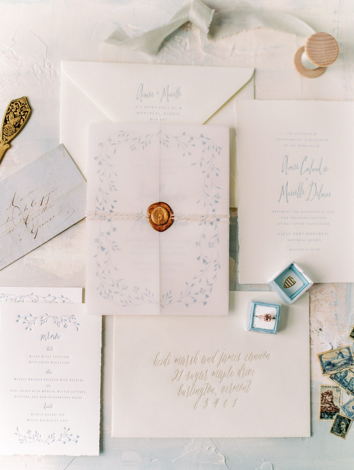 blue and white vintage invite with bronze wax seal