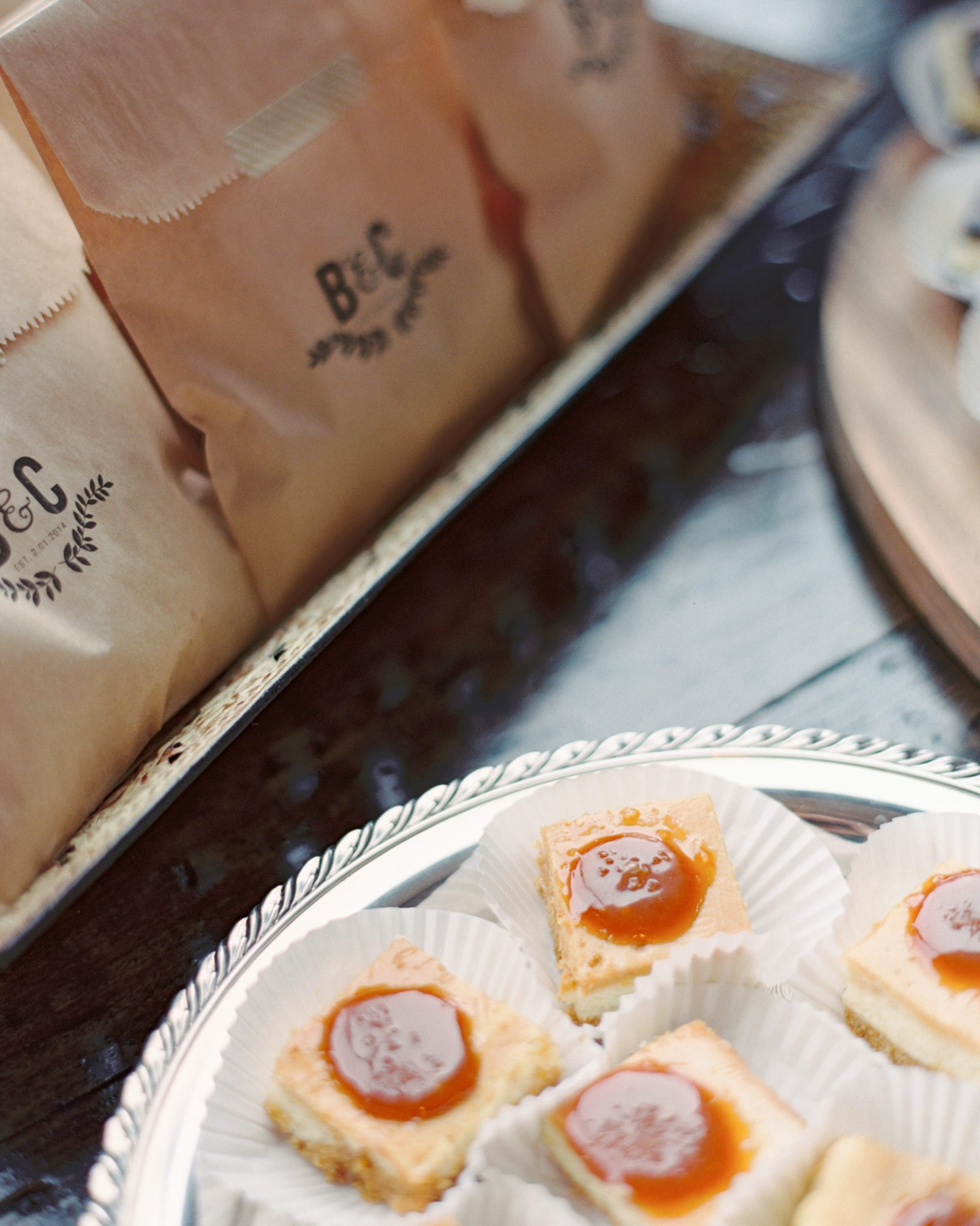 Cookie favors at this February wedding were gifted in brown sleeves that were stamped with the couple's logo and sealed with washi tape.