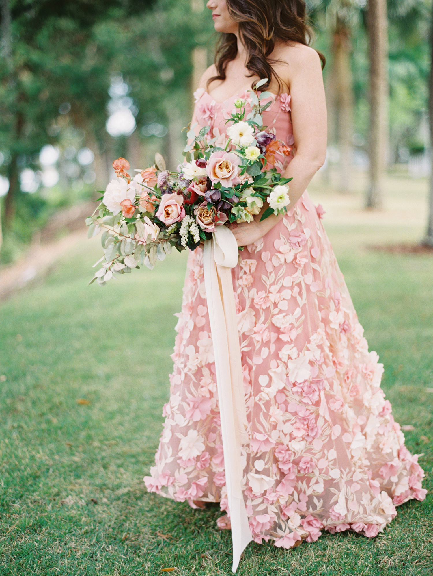 pink wedding dress with floral details