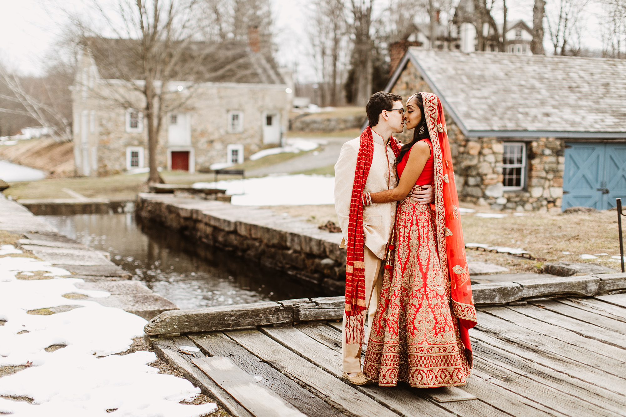 red and gold embroidered lehenga