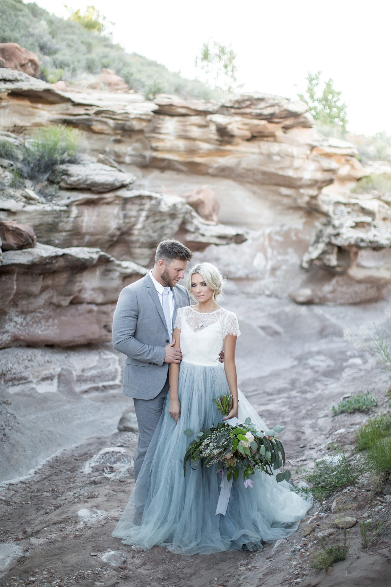 two-toned wedding dress with white top and blue tulle bottom