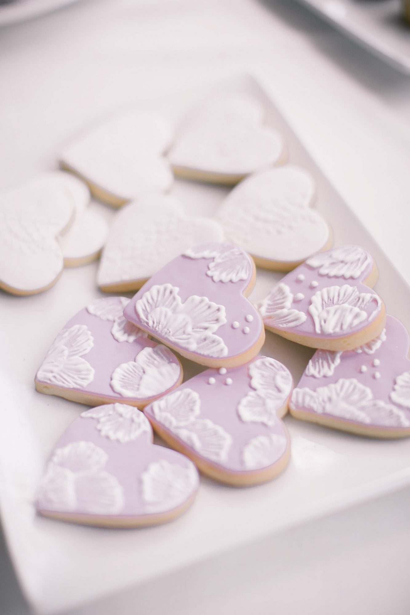 lilac and white floral frosted heart shaped cookies