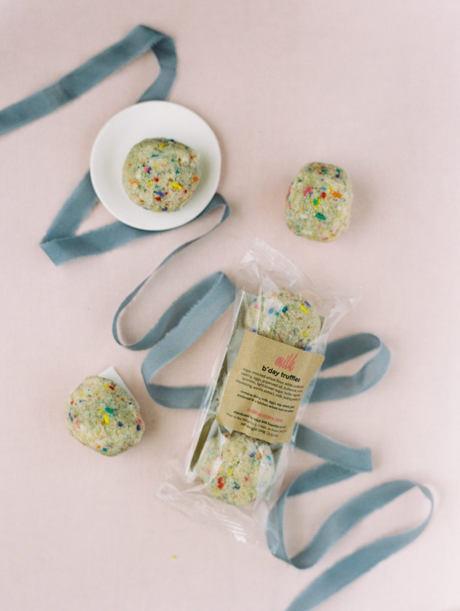 Play up your pastel color scheme with a unique take on truffles: Go the funfetti route. These multicolored truffles by Milk Bar were on full display in their clear packaging—all that was left to do was add a bow. We love how the choice of blue ribbon matched the sprinkles in the treats.