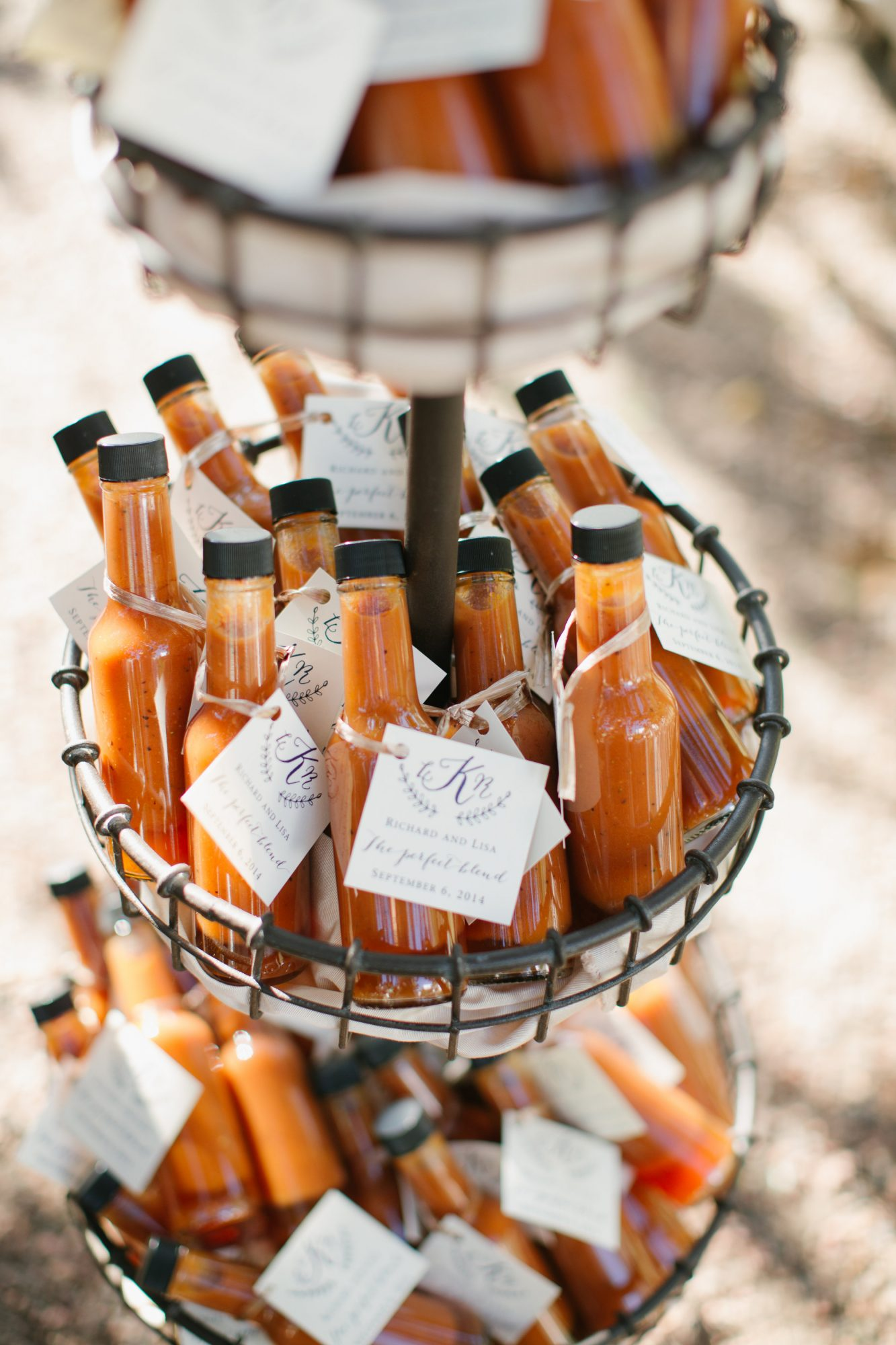 For a homespun twist on hot sauce wedding favors, we love how this bottle put the rich orange color of the sauce on display. A monogrammed label was the perfect finishing touch.