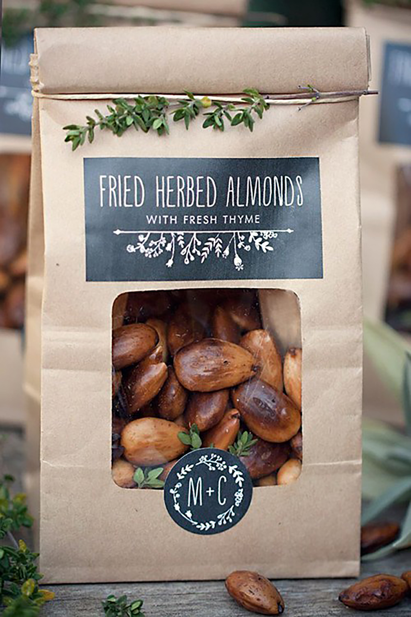 Elevating a simple snack bag doesn't have to be complicated. Hre, the couple made their fried herbed almonds unique by adding fresh thyme to the recipe and presenting the snack in a customized pouch from Evermine. The treats were garnished with greenery for an additional homemade touch.