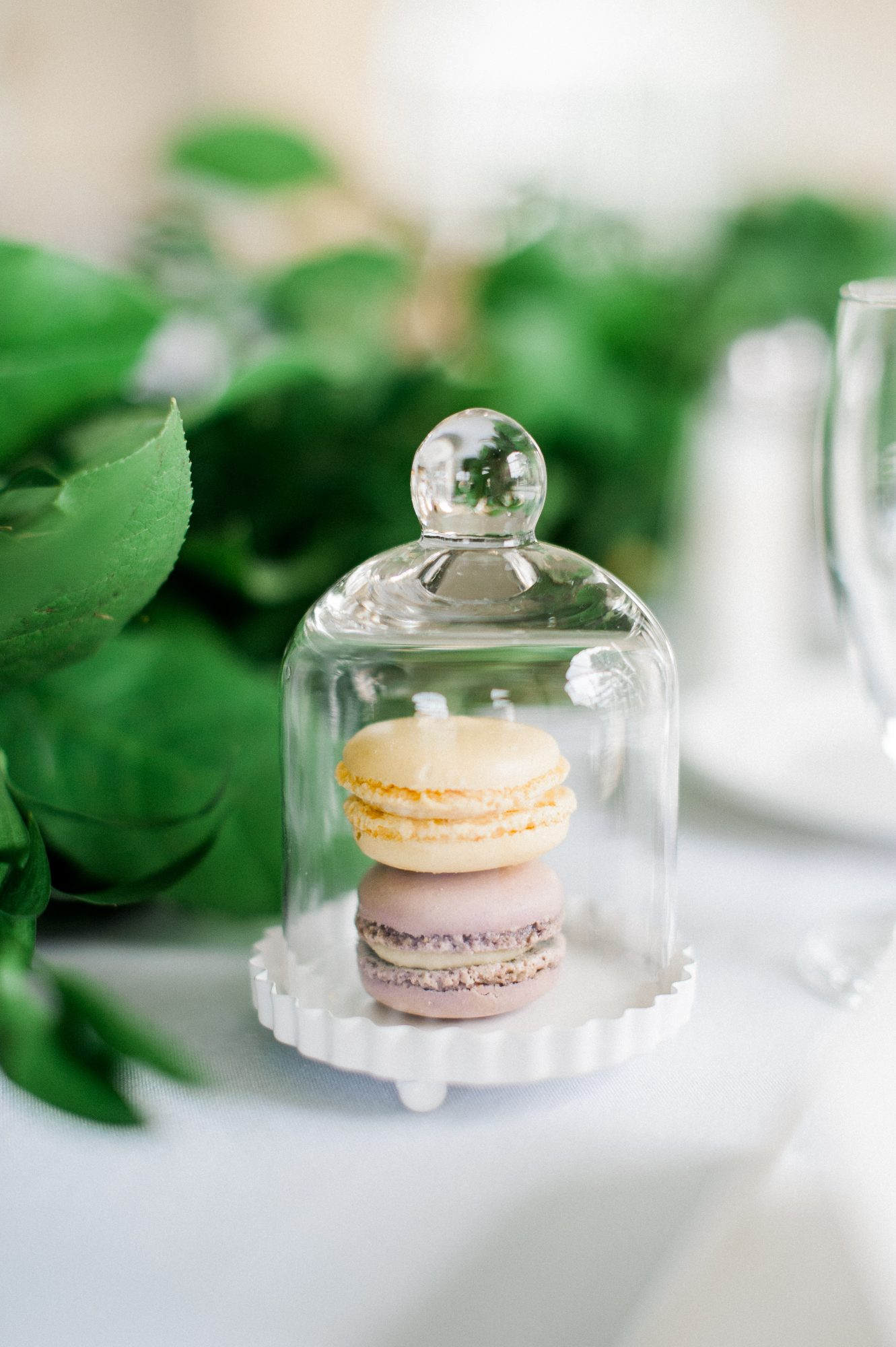 Wedding favors can double as table décor, like these macarons in see-through containers did.