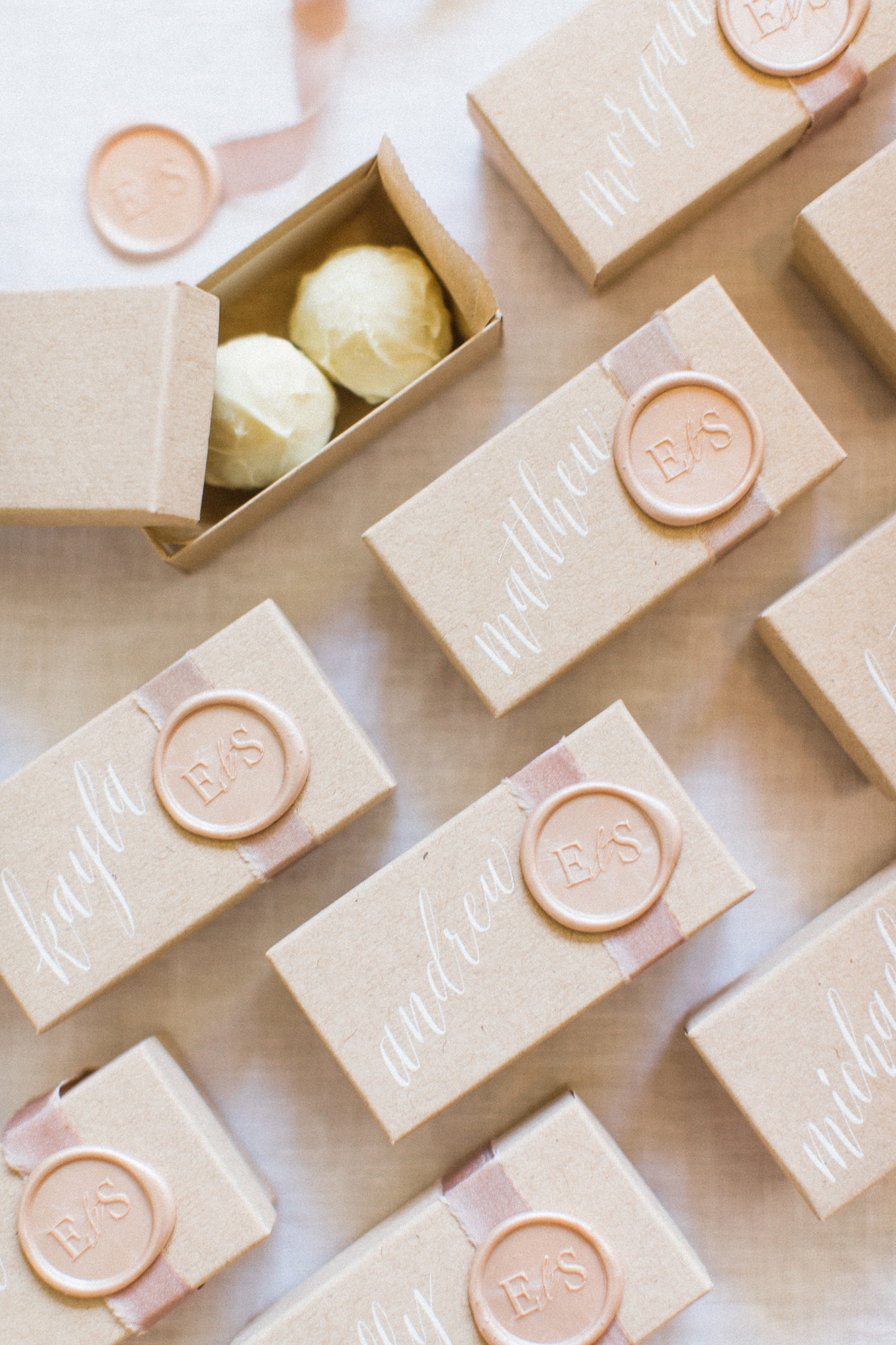 Truffles are always a popular wedding favor, which is why presentation can go a long way in helping your big day stand out from the rest. How elegant are these personalized boxes decorated with caligraphy by Miranda Writes, simple blush ribbons from FrouFrou Chic, and tan, monogramed wax stamps by Wax Seals? Guests surely held on to the packaging long after the truffles were gone.