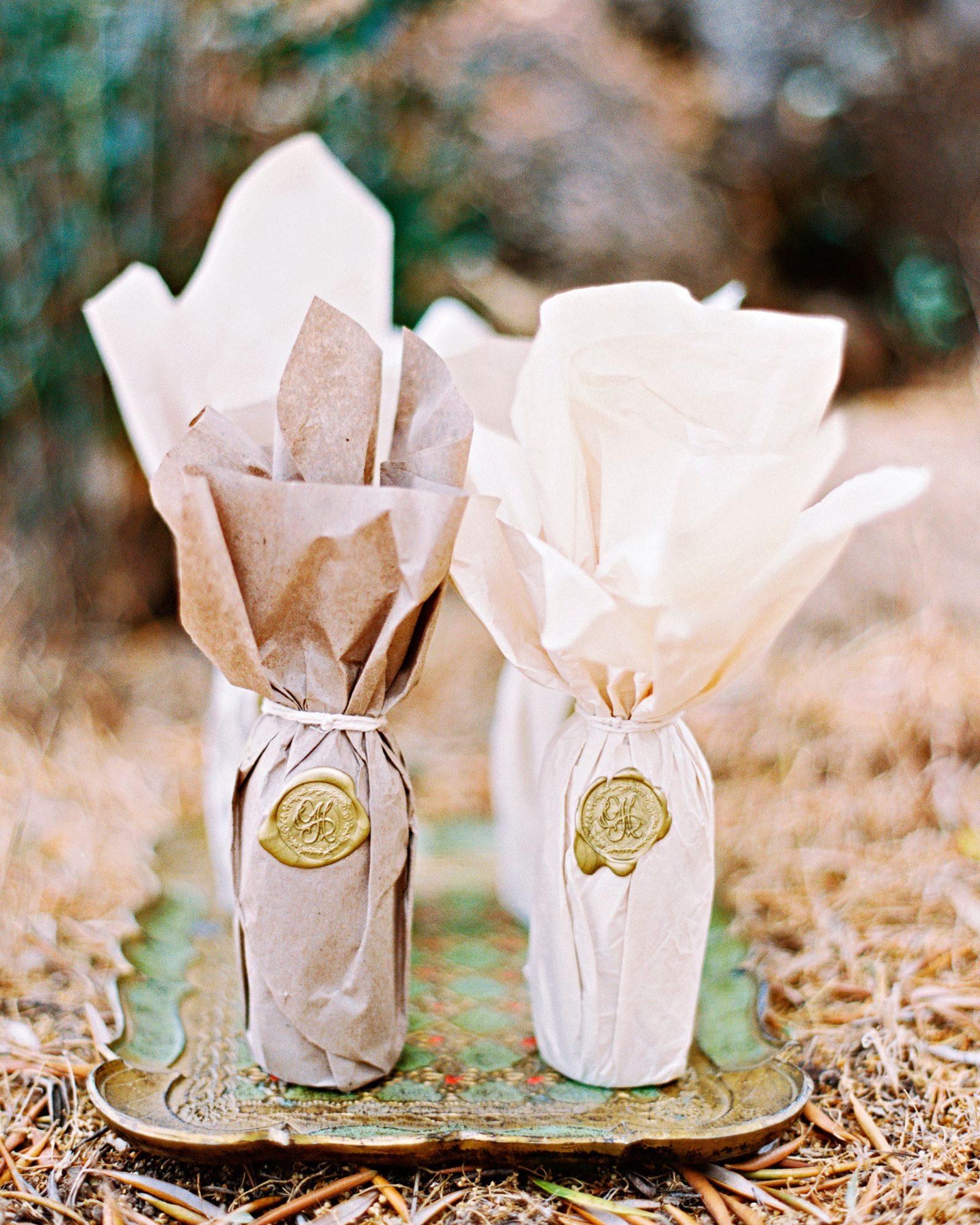 Favors included bottles of local olive oil, wrapped with the couple's wax seal.