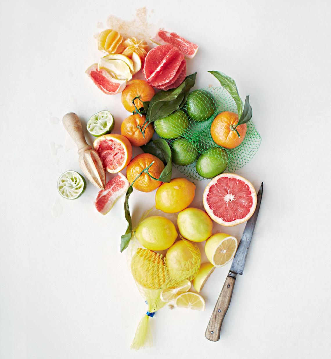 various citrus fruits and knife