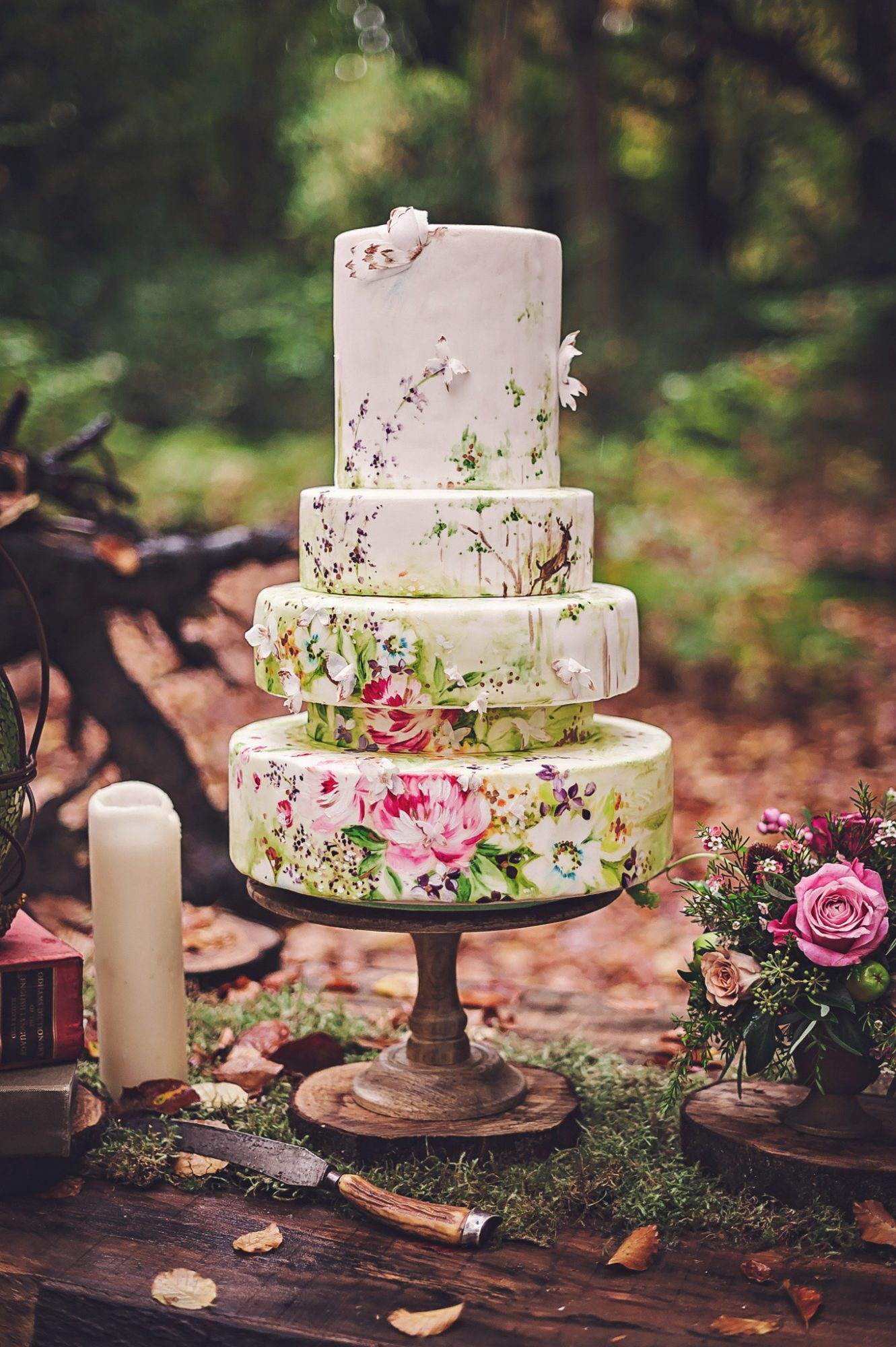 painted wedding cake with flowers