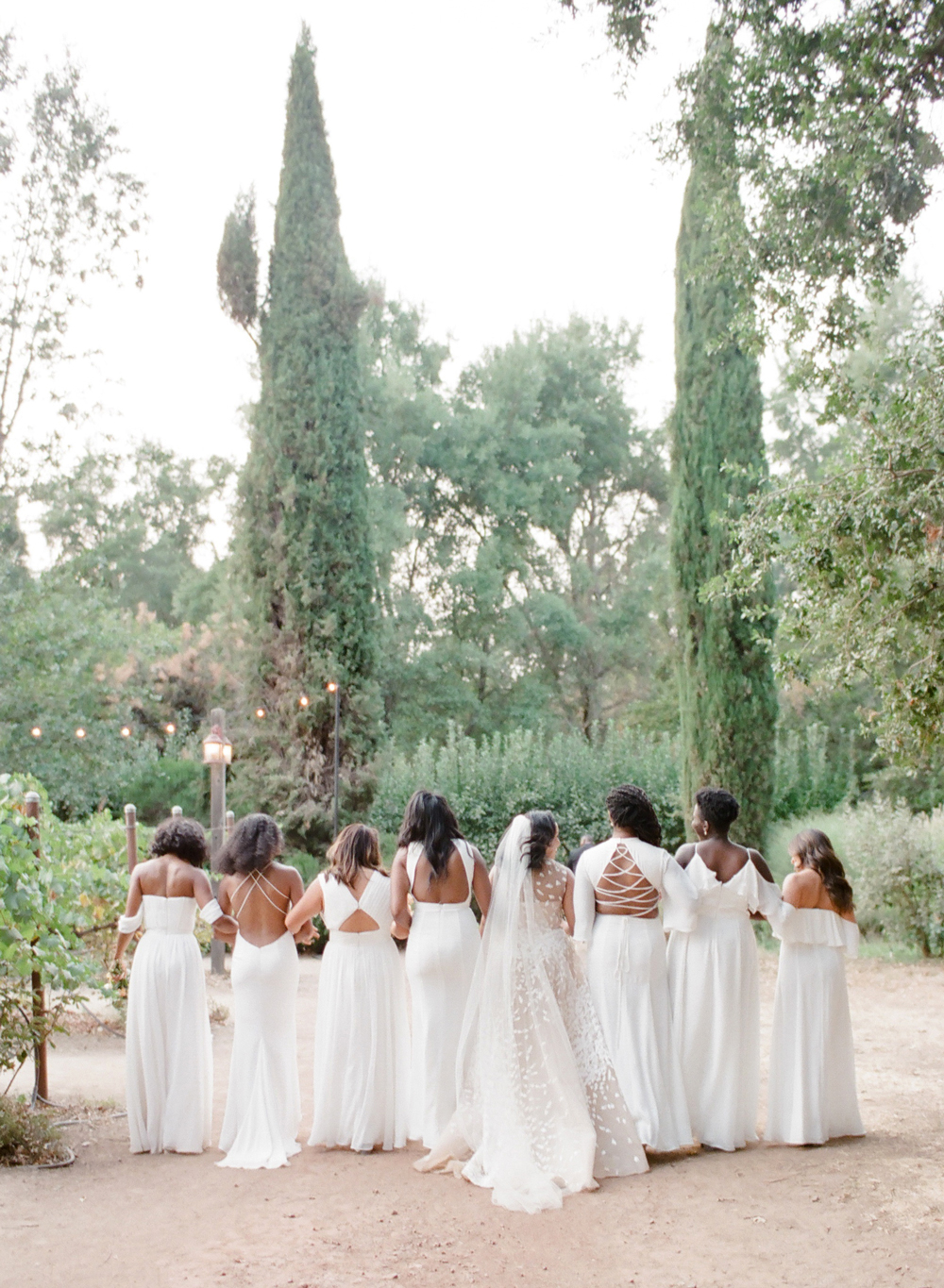 White Bridesmaids' Dresses with Dramatic Backs