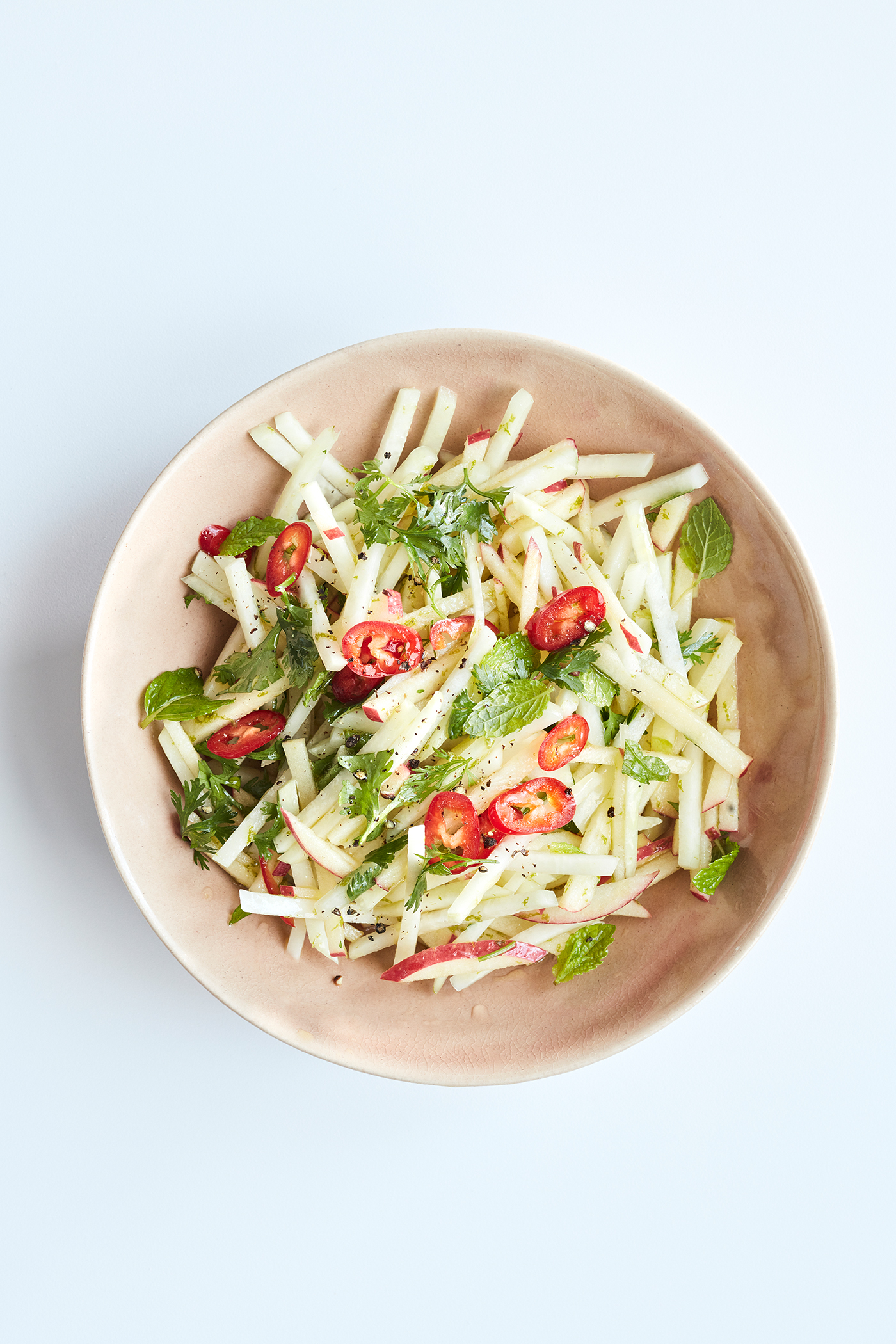 kohlrabi apple and mint slaw in white bowl