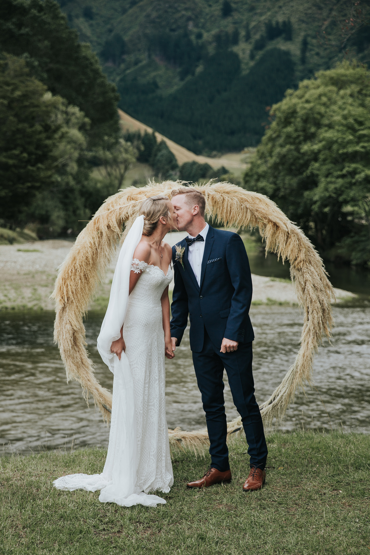 wedding wreath made of wheat with couple kissing