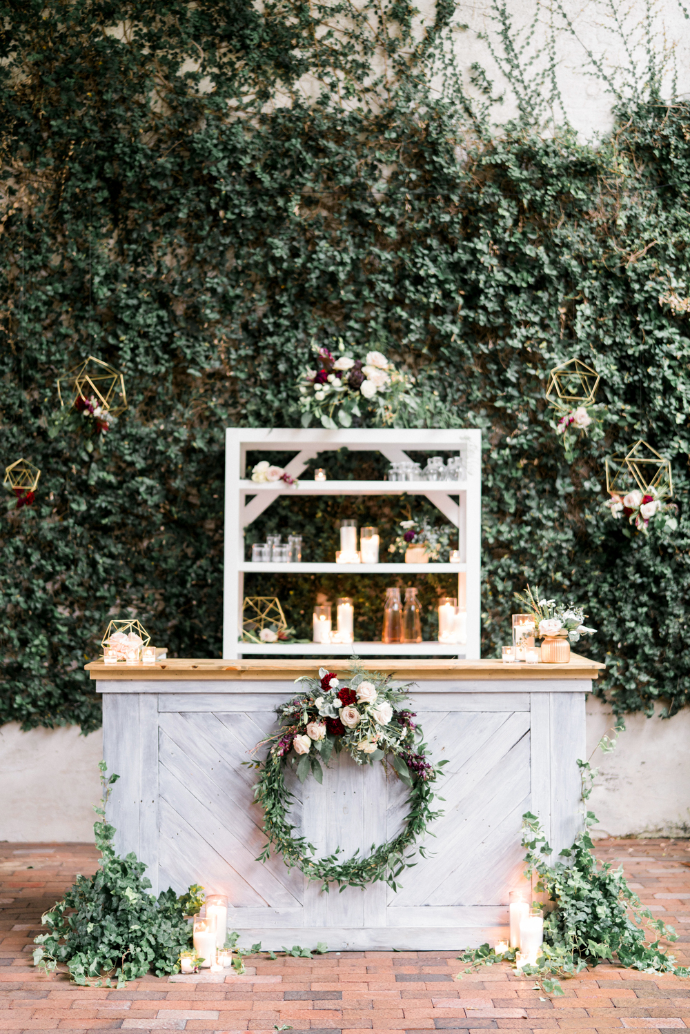 wedding wreaths decorating outdoor bar